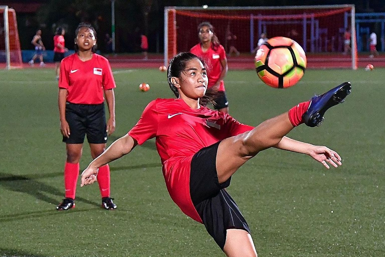 Stephanie Gigette Dominguez, 19, during training at Serangoon Stadium. The footballers need a decent run at the women's Asian Cup qualifiers to earn the approval of the SEA Games selectors.