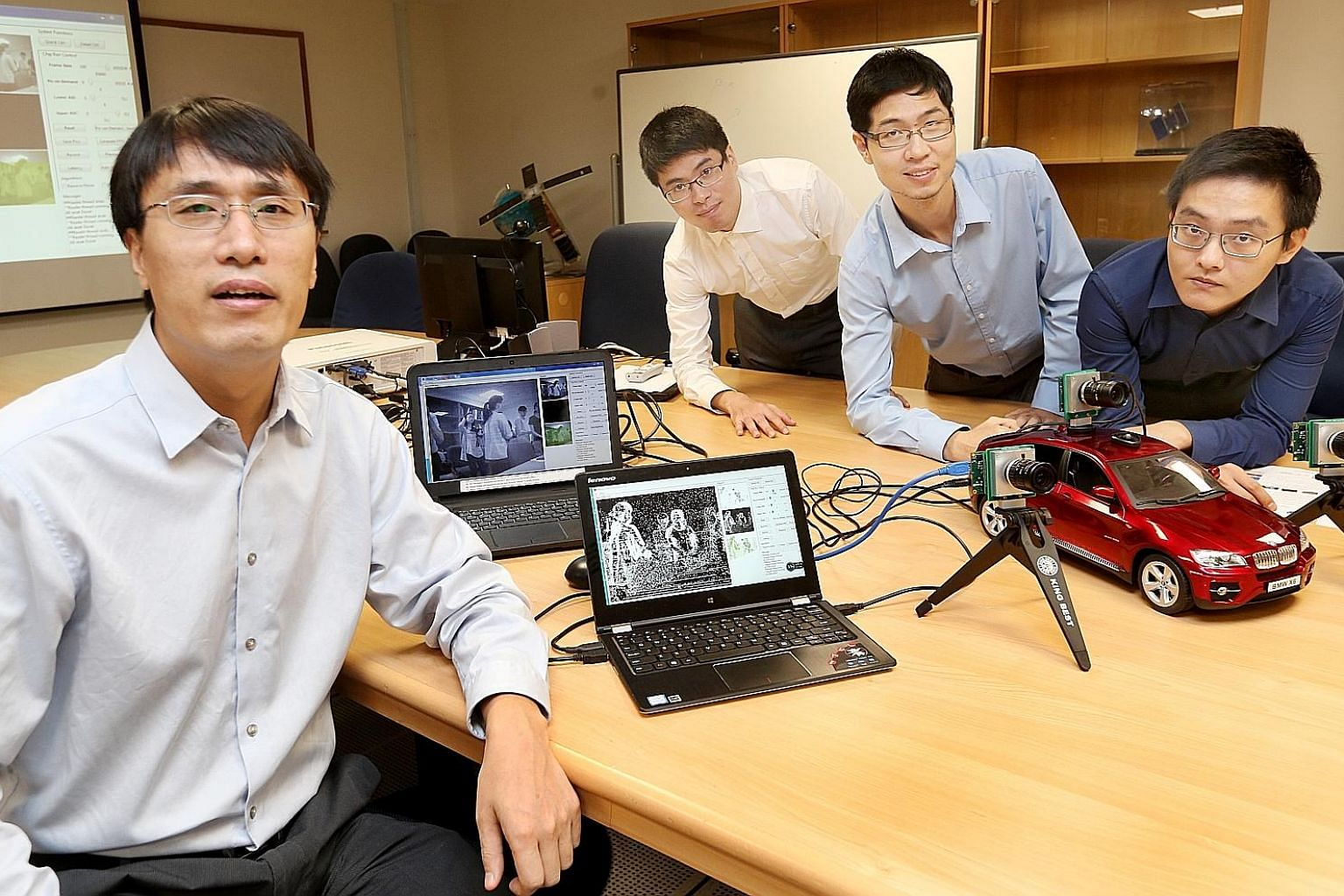 From left: Assistant Professor Chen Shoushun, 40, with researchers Guo Menghan, 28, Li Wan Long, 26, and Yang Wen Lei, 25, and the prototype camera named Celex. The ultra-fast camera mimics the capability of the human eye and can track minute changes