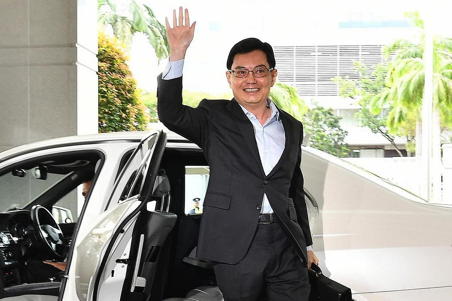 Mr Heng signalling that it was business as usual with a sweeping, confident wave as he arrived at Parliament House to deliver the Budget speech yesterday.