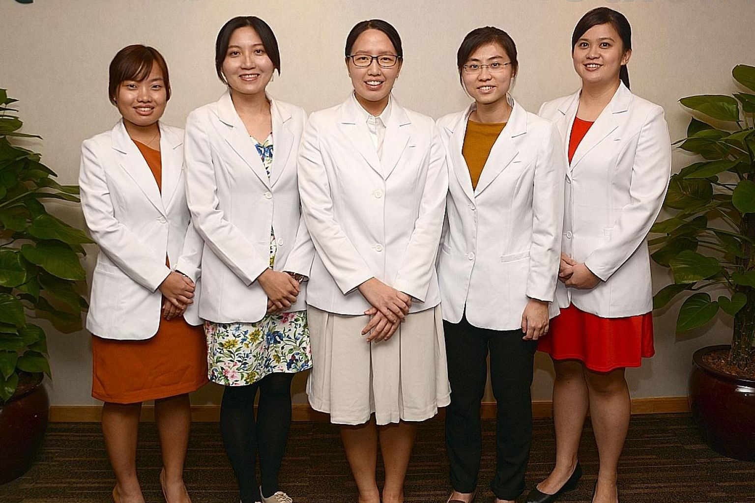 TCM physicians under age 40 at Raffles Chinese Medicine (from far left) Ms Tay Jia Ying, 28; Ms Tan Weii Zhu, 31; Ms Ong Fang Ying, 29; Ms Chua Hui Zi, 30; and Ms Ho Chin Ee, 31.