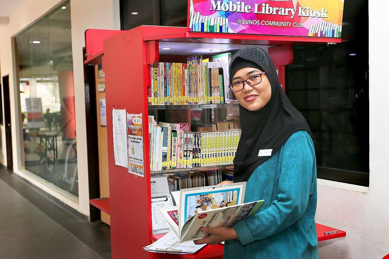Ms Farnizah works at the mobile library kiosk of Eunos Community Club under the CDC Community Employment Programme.