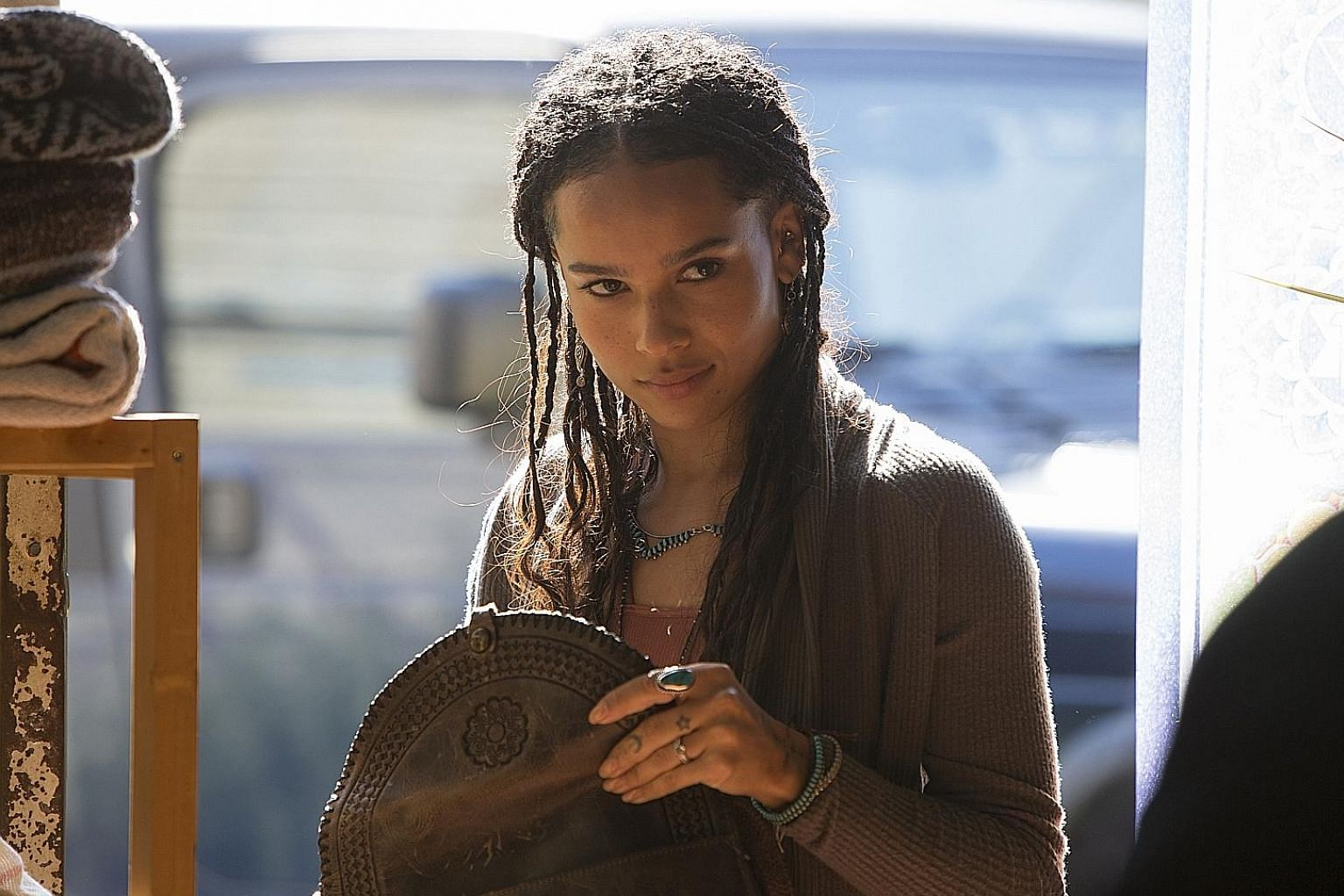 Zoe Kravitz (above) plays the young and hip Bonnie in Big Little Lies, while Timothy Olyphant is the husband of a flesh-eating woman (Drew Barrymore) in Santa Clarita Diet.