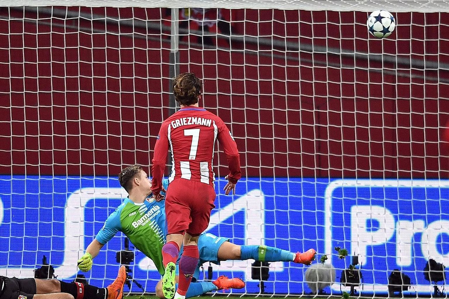 Antoine Griezmann watching his shot hit the back of the net via the crossbar to put Atletico two goals up in their 4-2 defeat of Bayer Leverkusen, as the beaten Bernd Leno can only watch on helplessly.