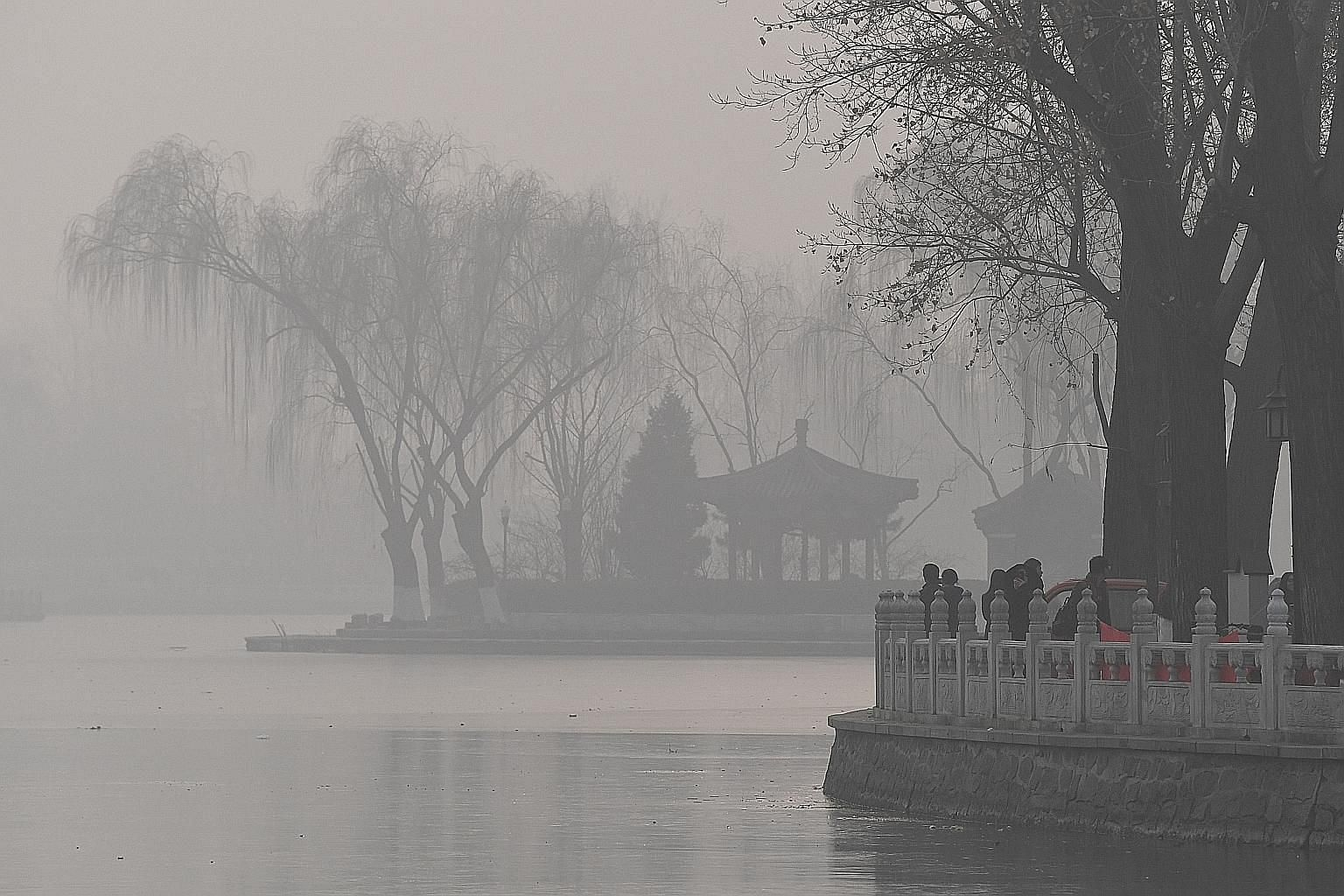 Smog blankets a lake in Beijing in January. Despite the Chinese government's stringent rules on pollution control and emissions, improvement in air quality continues to fall short of public expectations, especially in the north of the country, which