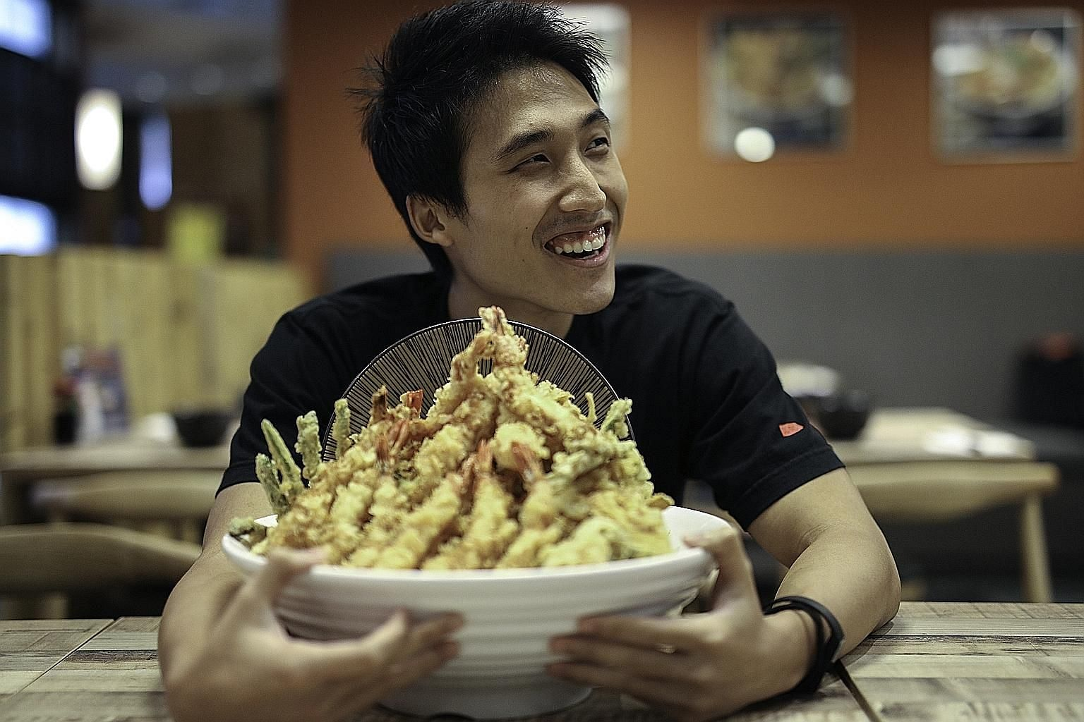 Mr Zermatt Neo finished a 3.2kg bowl of tendon - tempura on Japanese rice - in 20 minutes and 39 seconds at Ramen Champion's new Don Meijin at Bugis+.