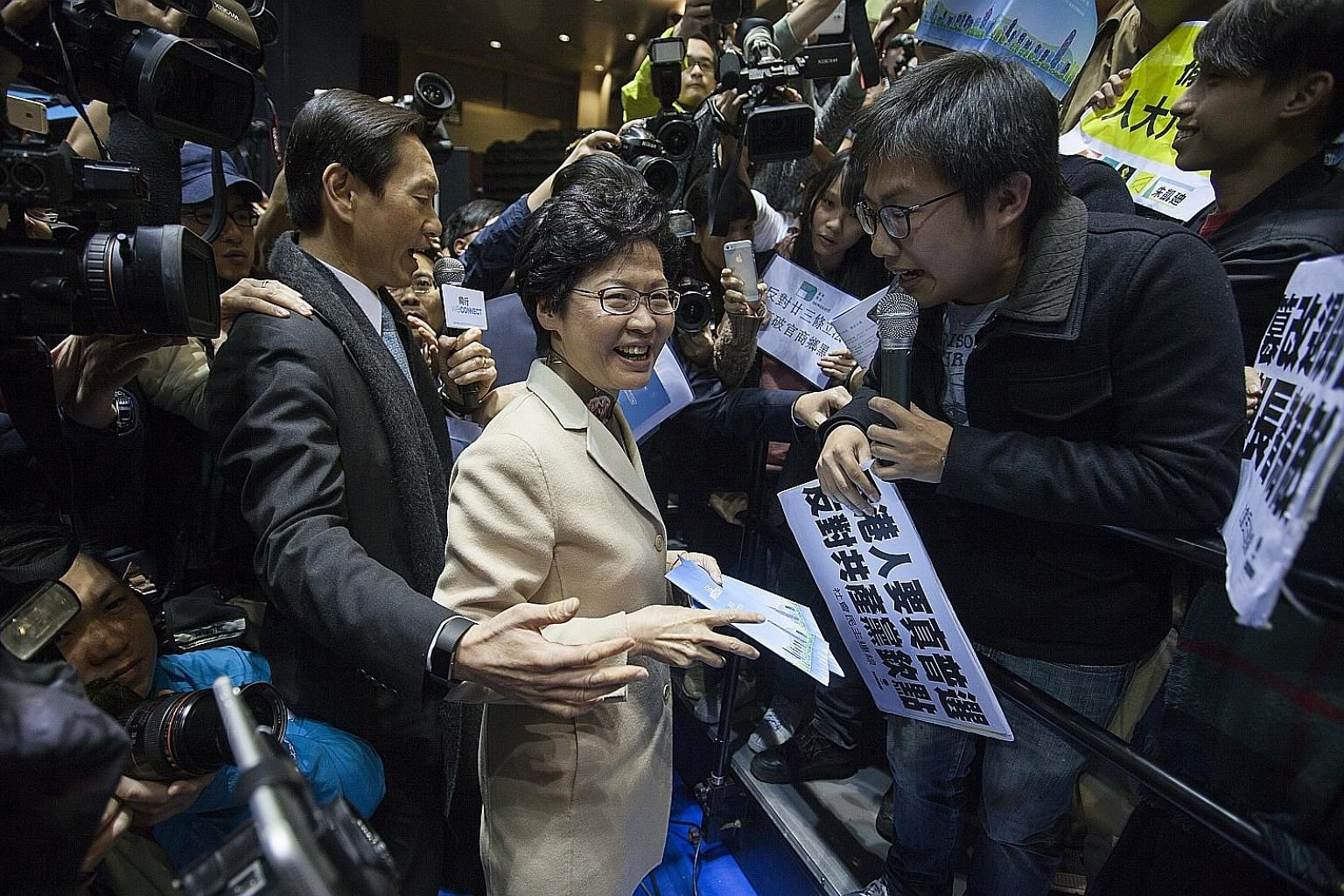 Mrs Lam, the leading candidate to be Hong Kong's next chief executive, facing off against pro-democracy protesters calling for real universal suffrage after launching her policy platform yesterday.