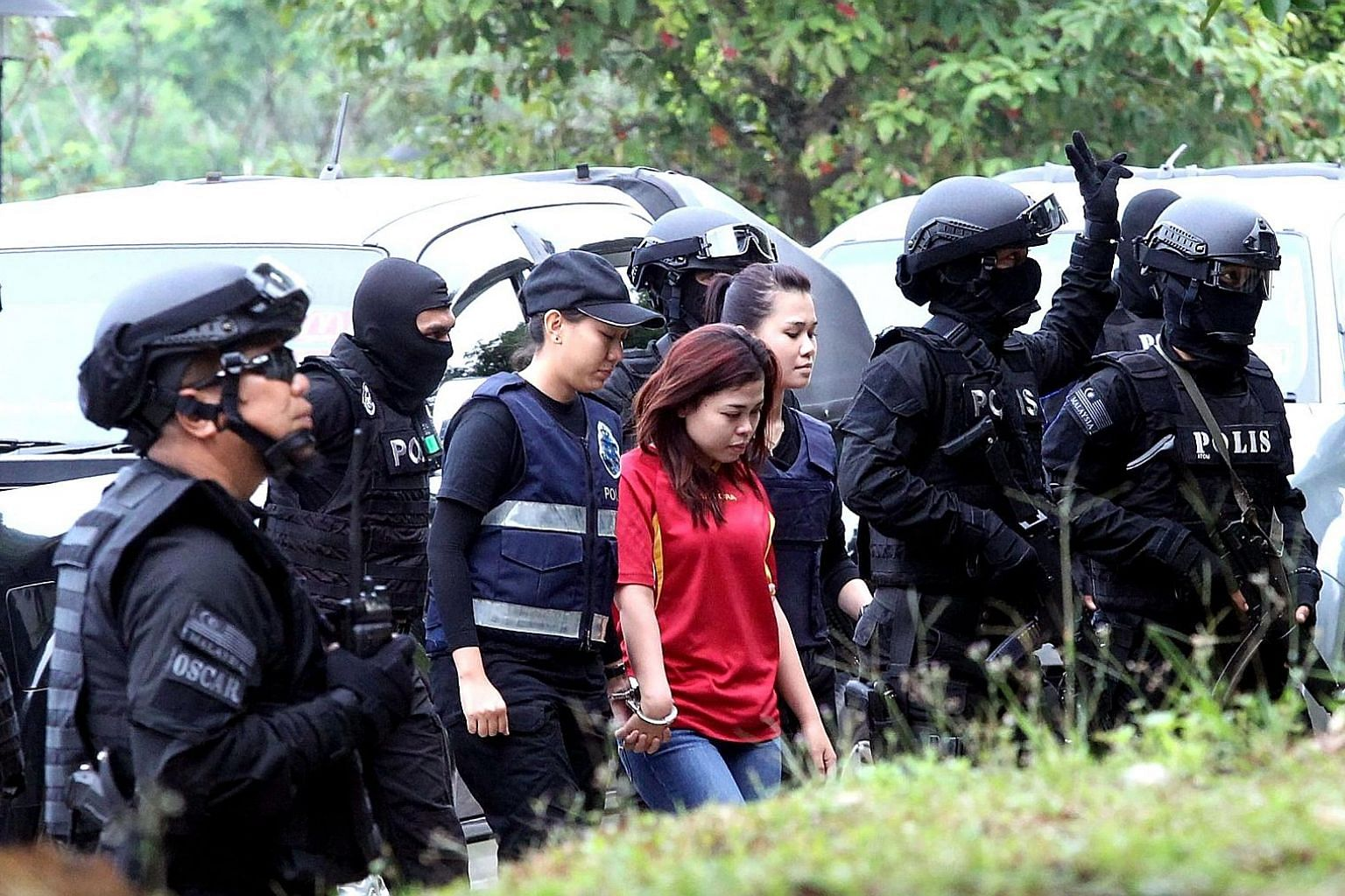 Indonesian suspect Siti Aisyah on her way to court in Sepang yesterday, where she and Vietnamese suspect Doan Thi Huong were charged with Mr Kim Jong Nam's murder.