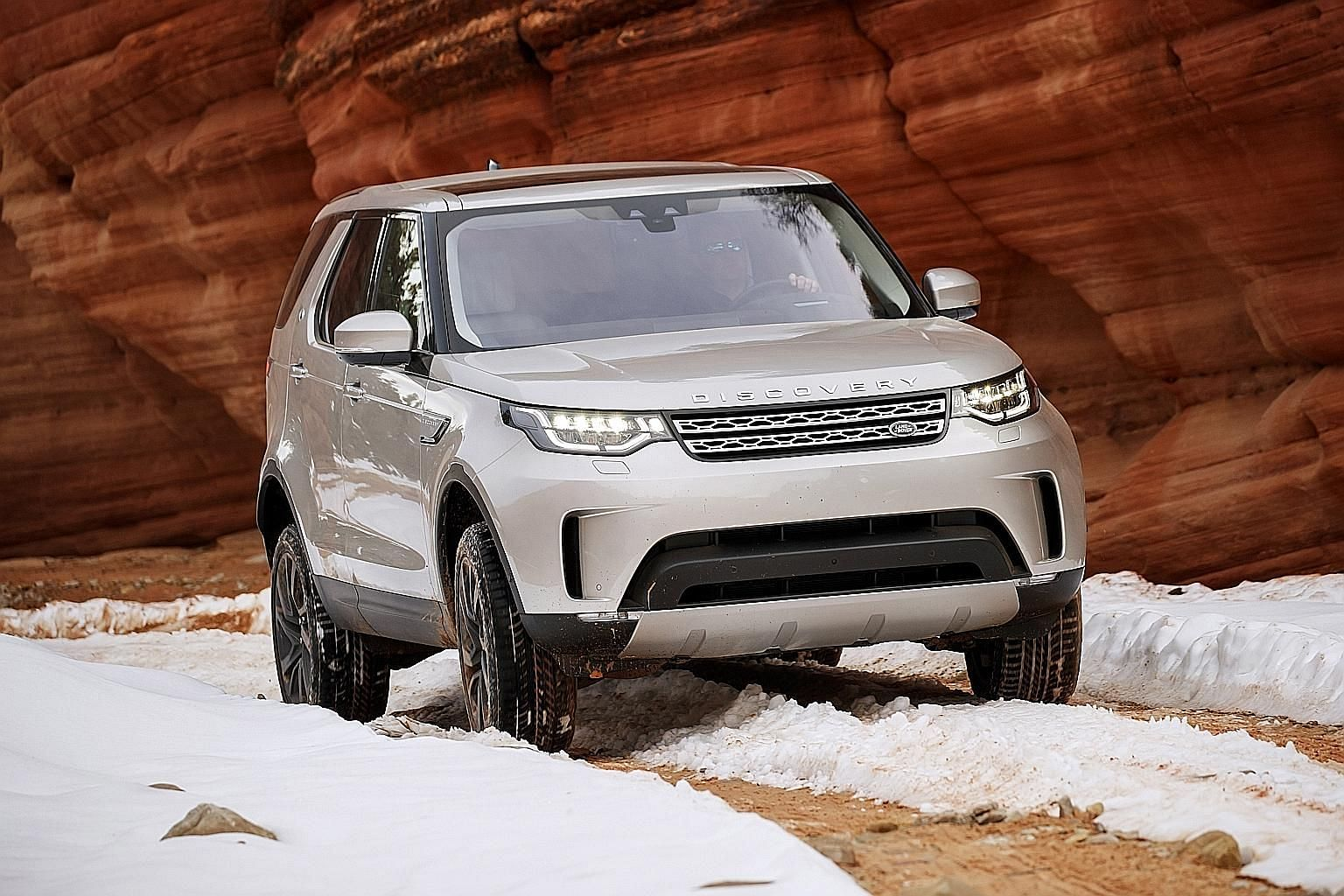 The new Land Rover Discovery is a cross between the luxurious Range Rover and the utilitarian Defender.