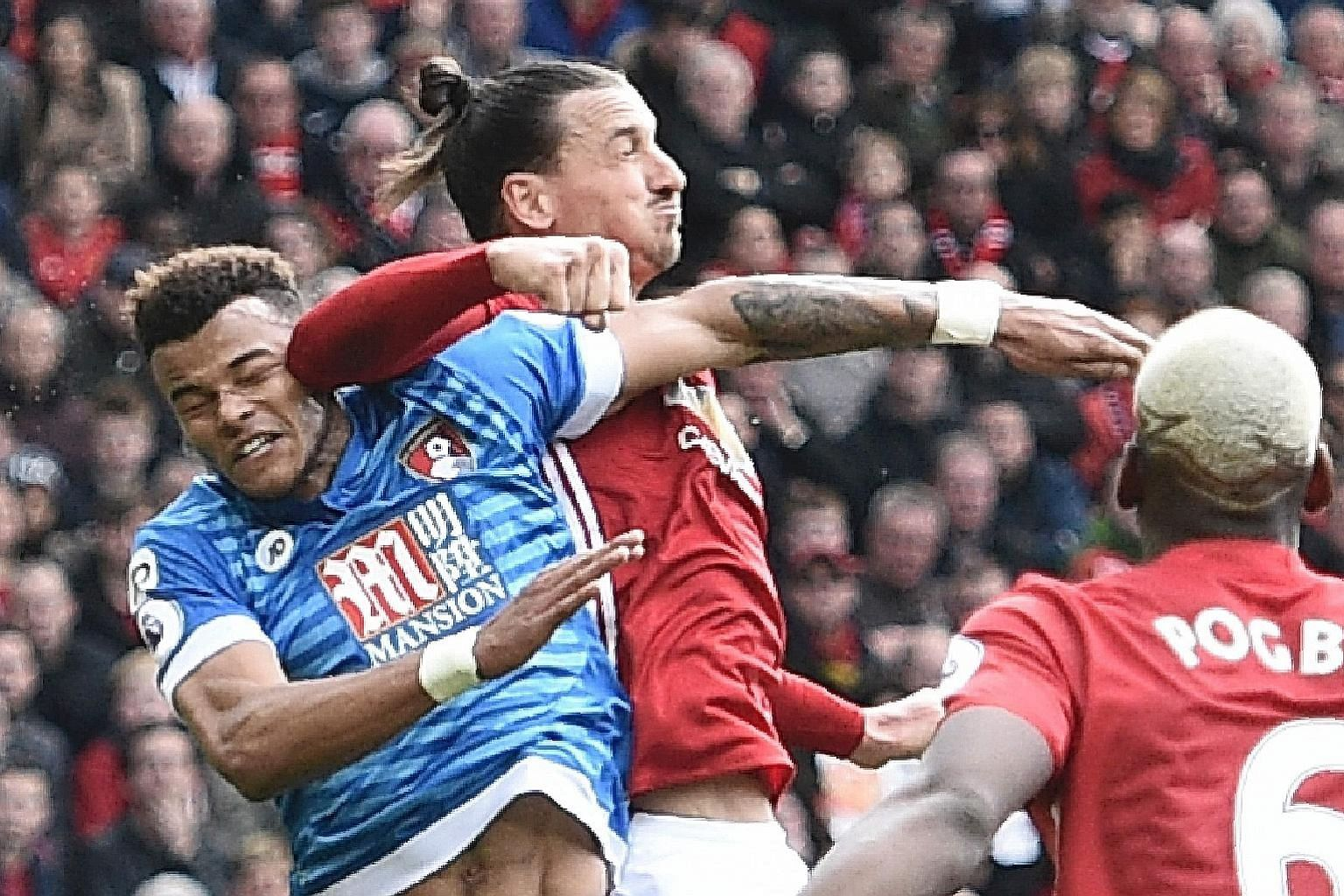 The contentious moment of the match, as Man United striker Zlatan Ibrahimovic (left) seemingly lands an elbow on the head of Bournemouth defender Tyrone Mings during their 1-1 Premier League draw at Old Trafford yesterday.