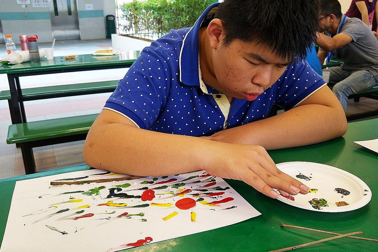 Boon Hong enjoying finger-painting at the headquarters of voluntary welfare organisation AWWA. Caring for the 15-year-old, who has epilepsy, has been exhausting work for his mother. But since last year, she has been getting some respite every Saturda