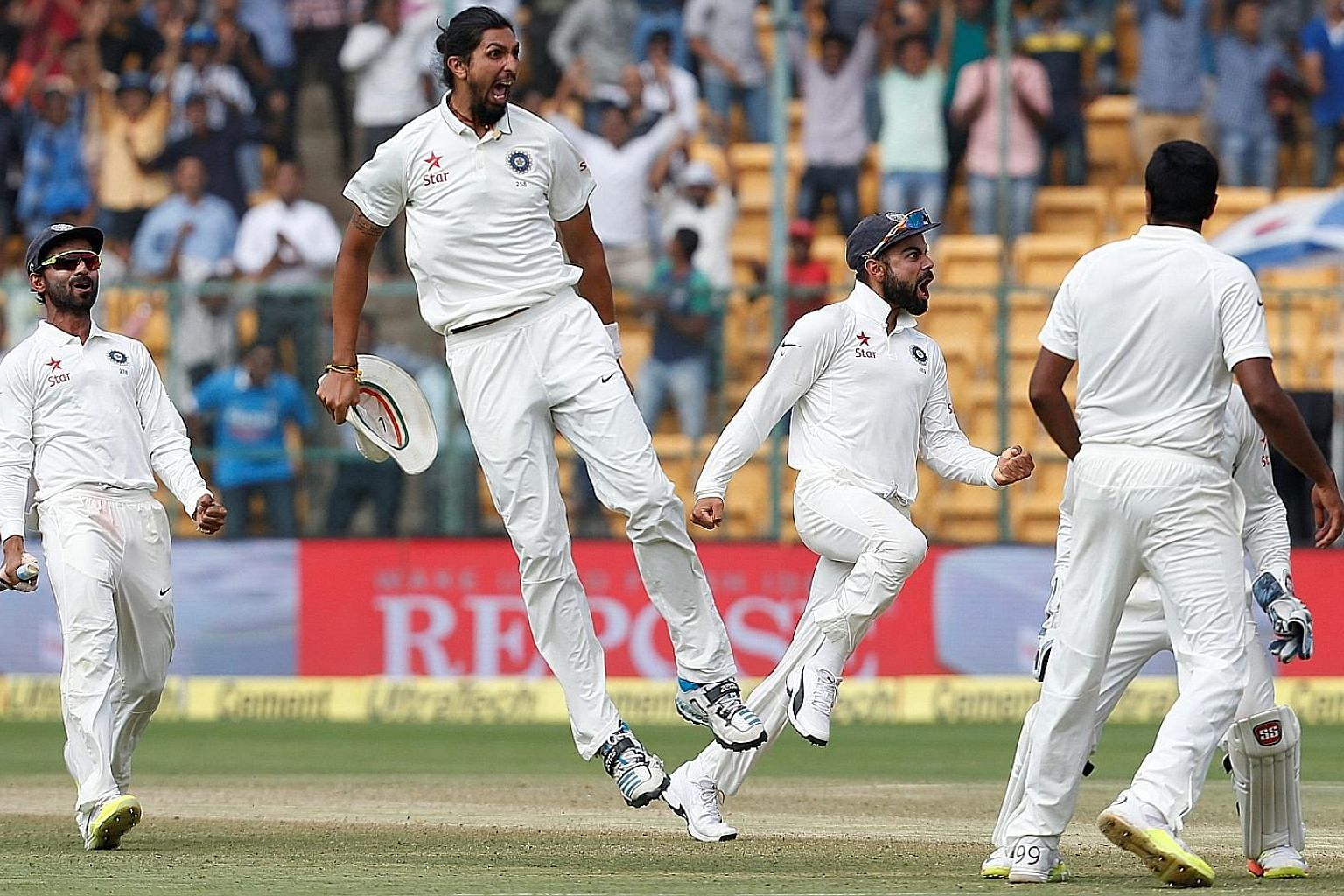 India captain Virat Kohli (third from left) celebrates with team-mates after their 75-run victory in the second Test against Australia in Bengaluru. The four-match series between the world's top two sides is level at 1-1.