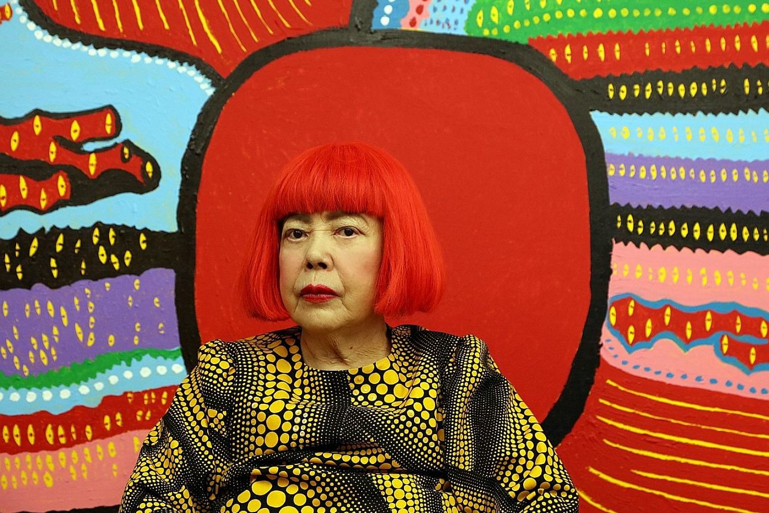 Yayoi Kusama in front of her latest work, Life Is The Heart Of A Rainbow, which will be on display at the National Gallery Singapore exhibition.