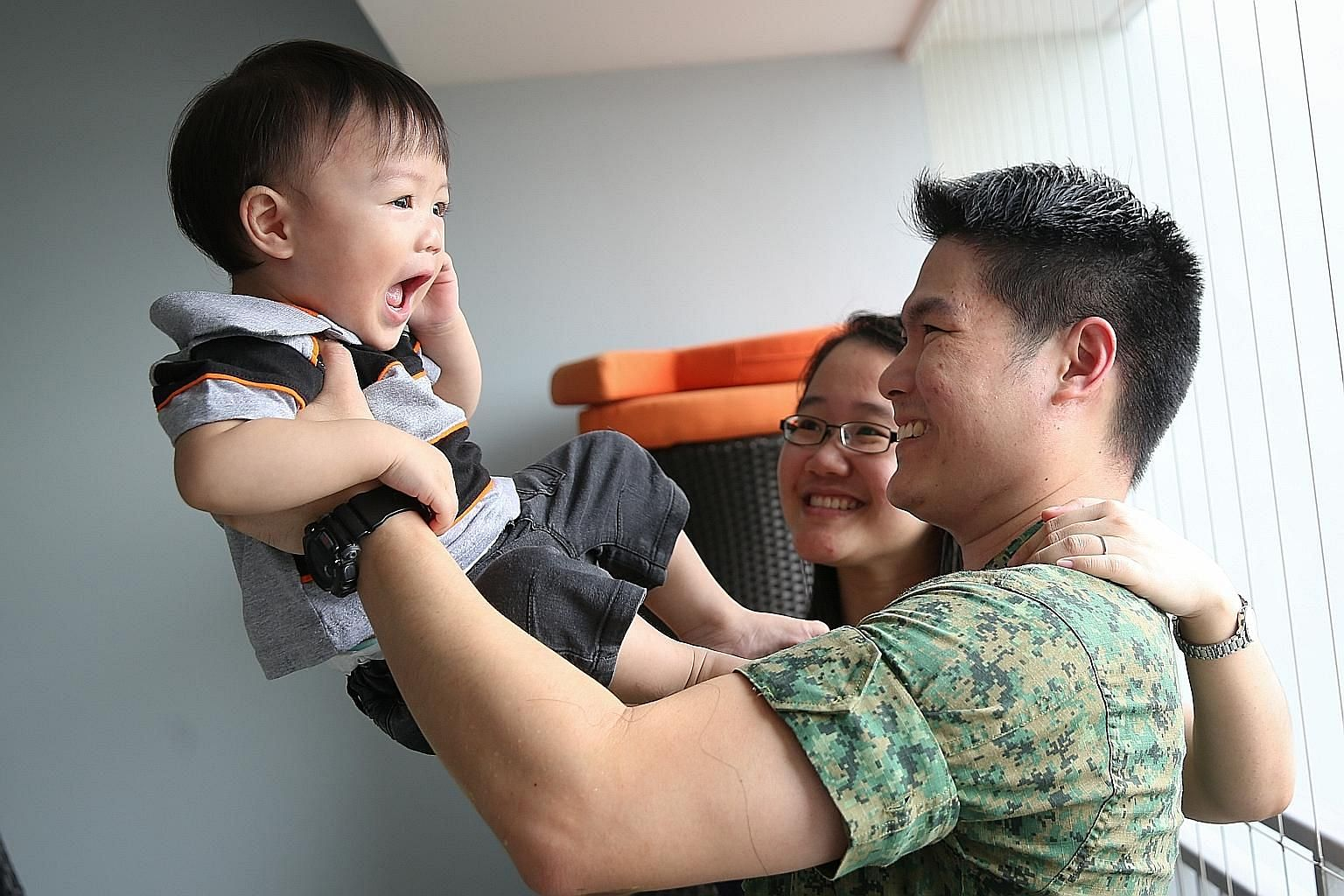Mr Lim with his wife Joanne and son Benjamin. With the Singapore Armed Forces becoming a more advanced fighting force, which leverages the latest in weapons and training systems, the ICT cycle can be reduced without compromising the SAF's operational
