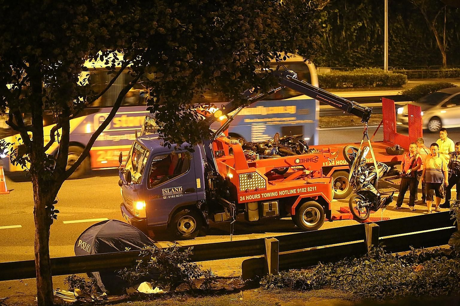 The accident on the BKE last Saturday killed two men and left six injured when a van hit motorcyclists taking shelter under a flyover.