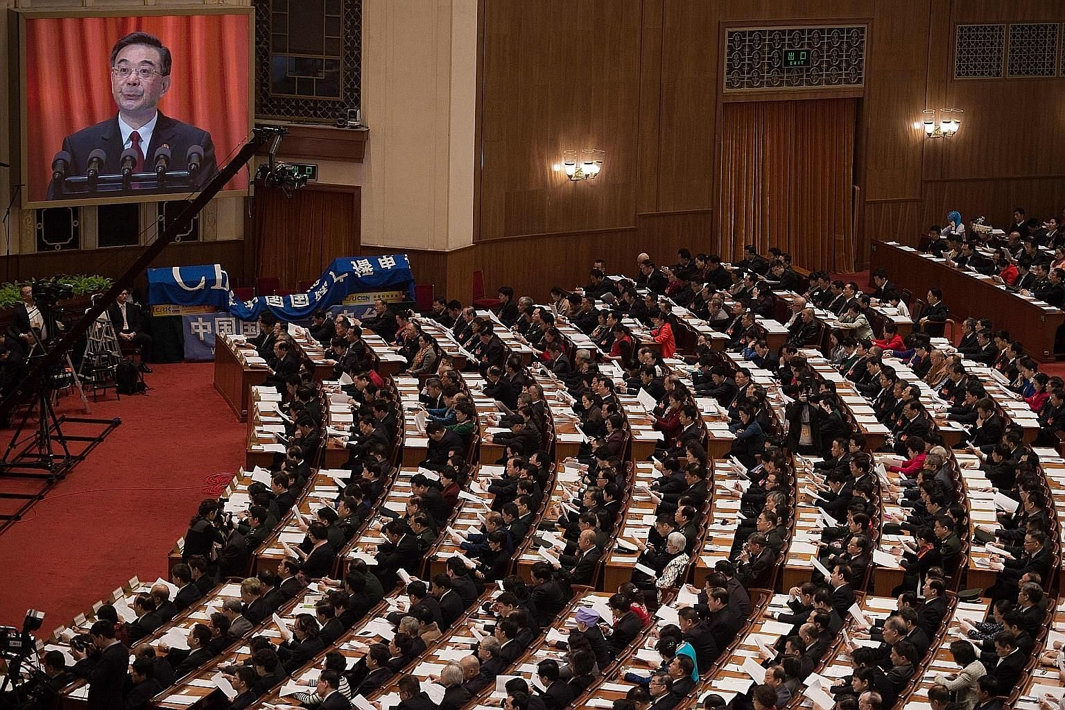 Chief Justice Zhou Qiang giving the report of the Supreme People's Court yesterday. He and Procurator-General Cao Jianming provided updates on the anti-graft situation.