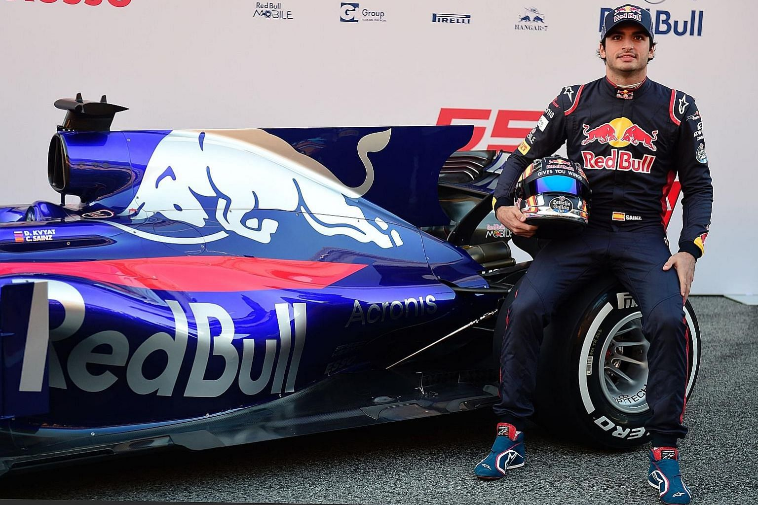 Toro Rosso driver Carlos Sainz with his new STR12 car during the official presentation.