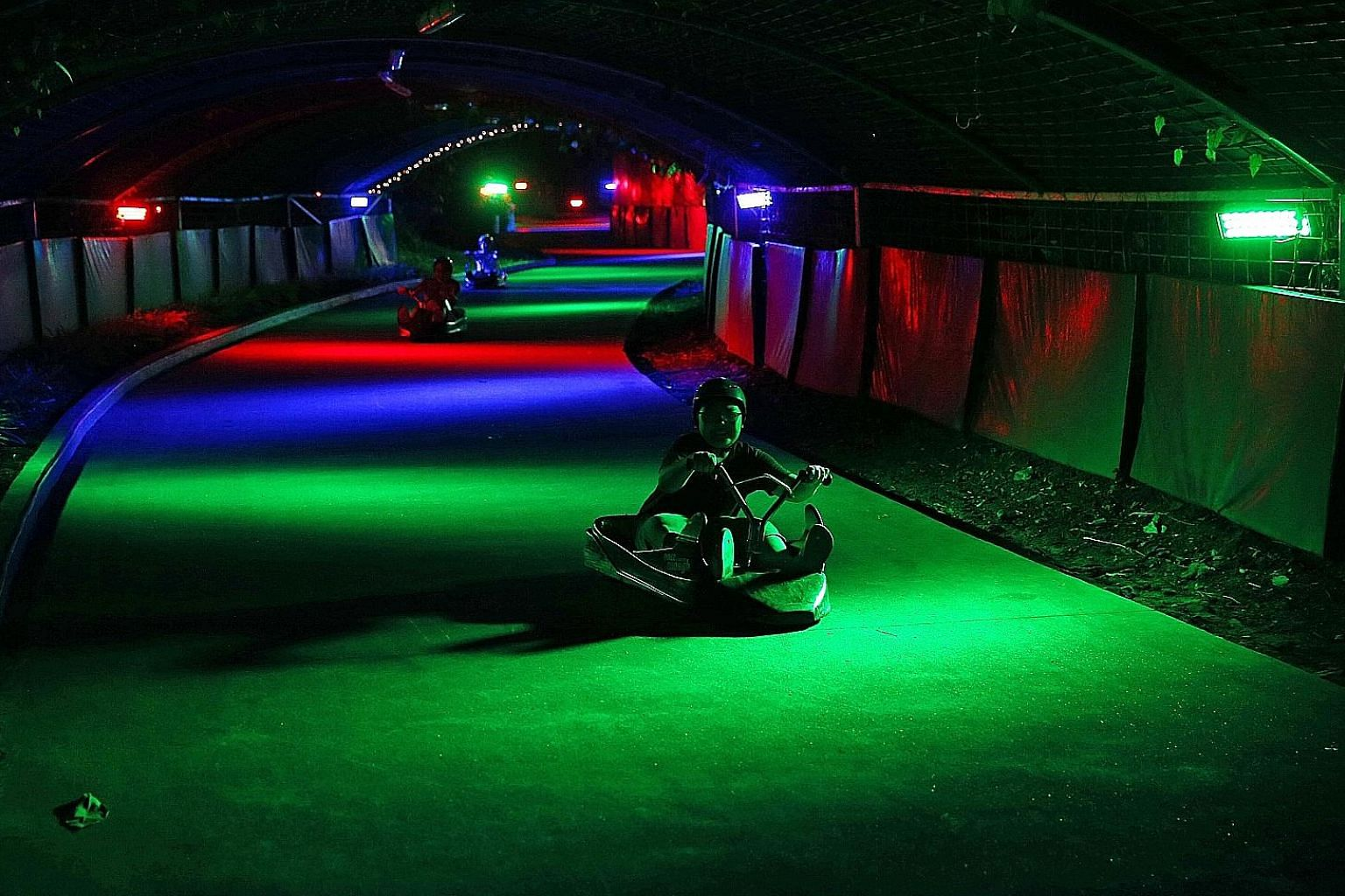 Skyline Luge Sentosa stays open till 9.30pm daily and its two luge trails glow with multi-coloured lighting in the evening.