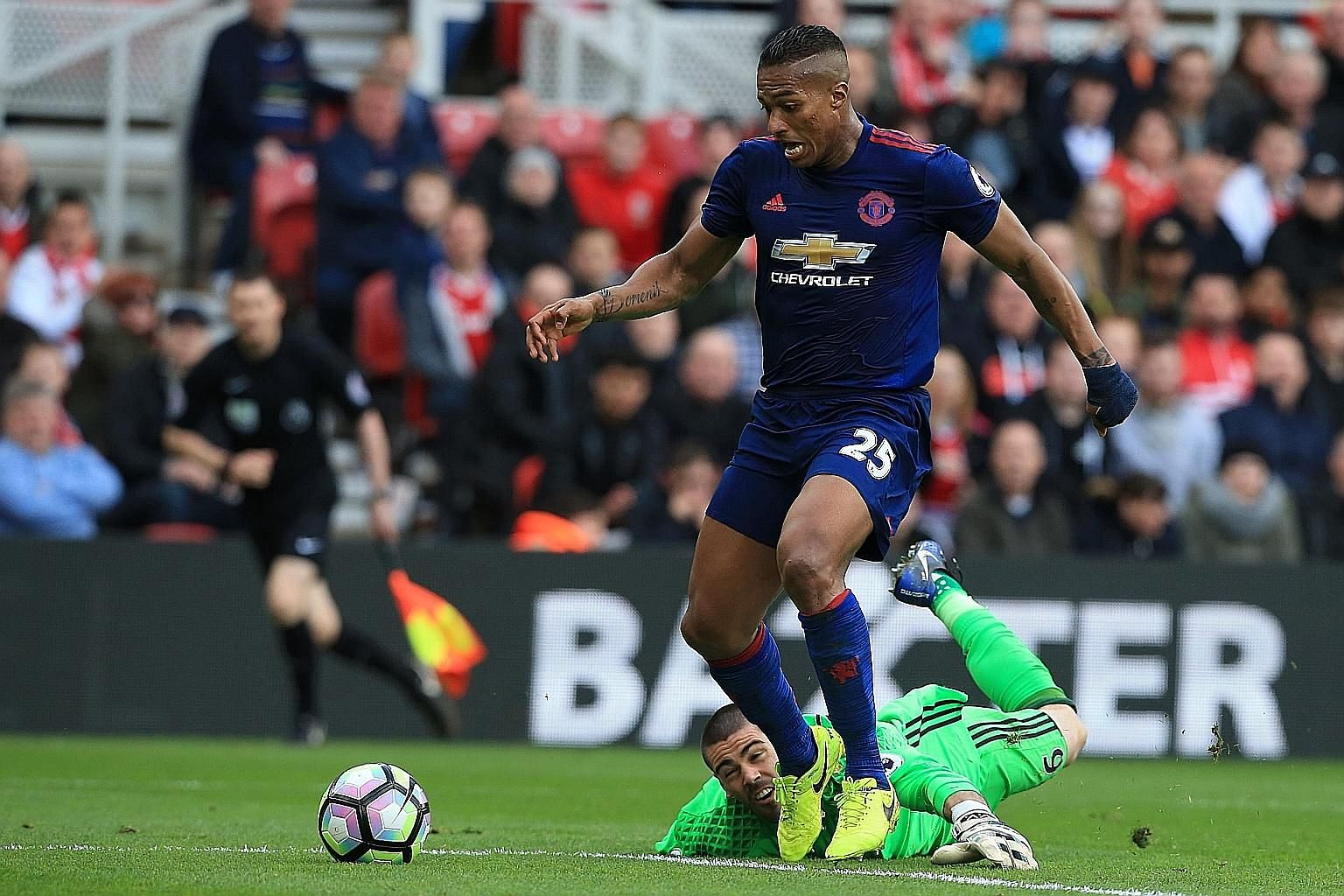 Manchester United's Ecuadorian right-back Antonio Valencia walking in their third goal after a mistake by Middlesbrough's Spanish goalkeeper Víctor Valdes during their English Premier League clash yesterday.