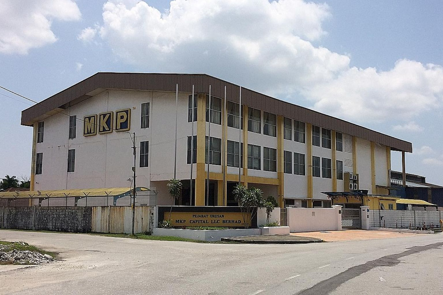 An MKP subsidiary's office (left) is shuttered, with old bills from 2015 left behind. Meanwhile, North Korean partner Han Hun Il's apartment in Kuala Lumpur appeared occupied, but no one answered when The Straits Times visited. Malaysian firm MKP Hol