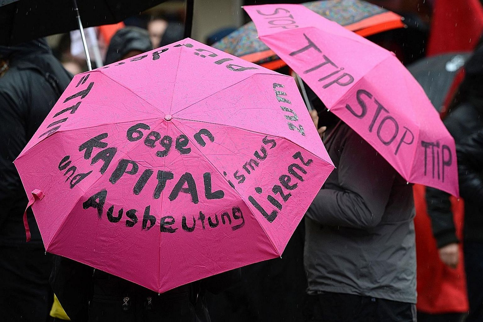 """An umbrella protest """"against capitalism and exploitation"""" by demonstrators on the sidelines of the G-20 meeting last Saturday."""