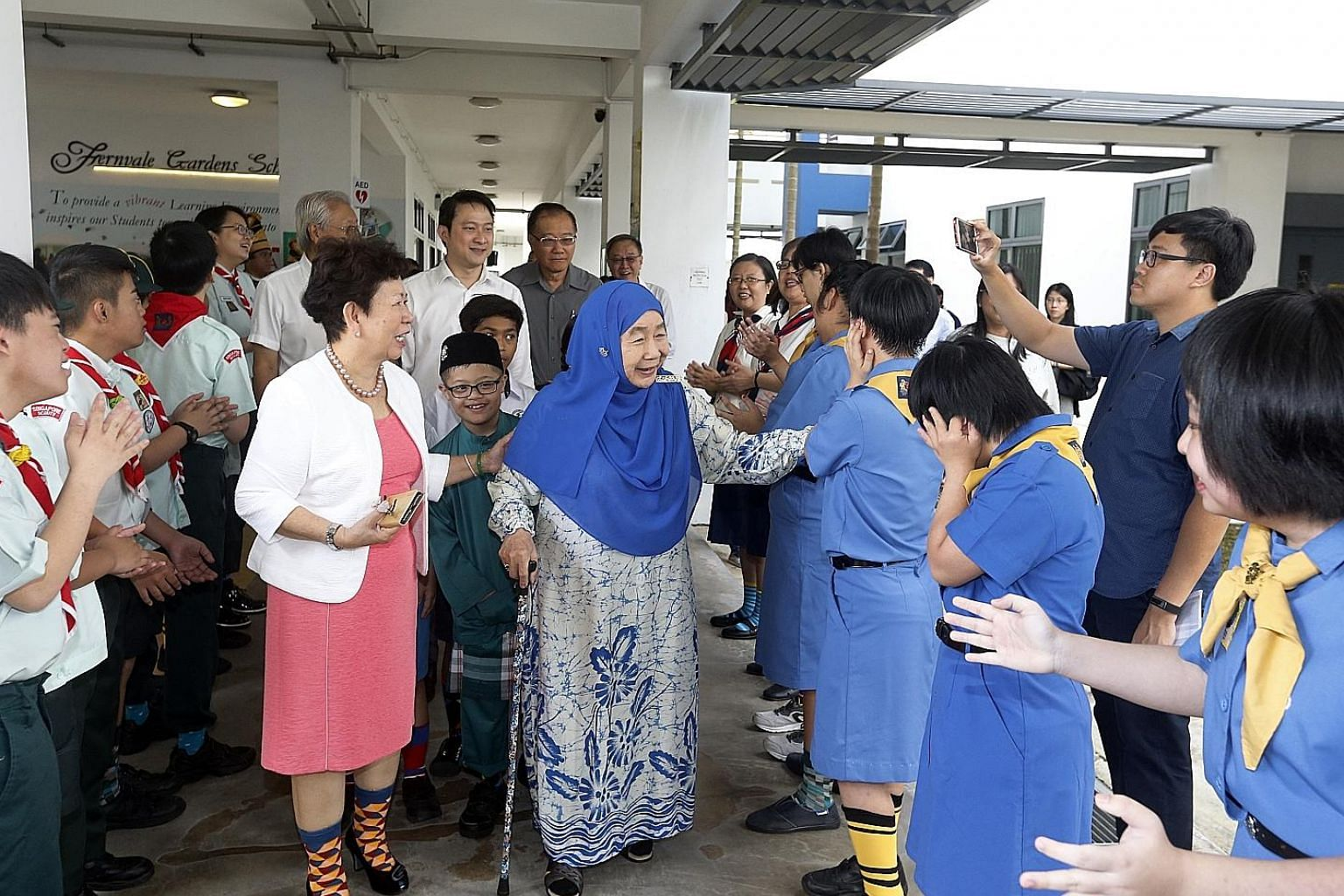 The Friendship Gate has linked Fernvale Gardens School and Fernvale Primary School since 2010, to facilitate interactions between pupils of both schools. Wife of the late president Yusof Ishak, Puan Noor Aishah, at the launch of a new buddy reading p