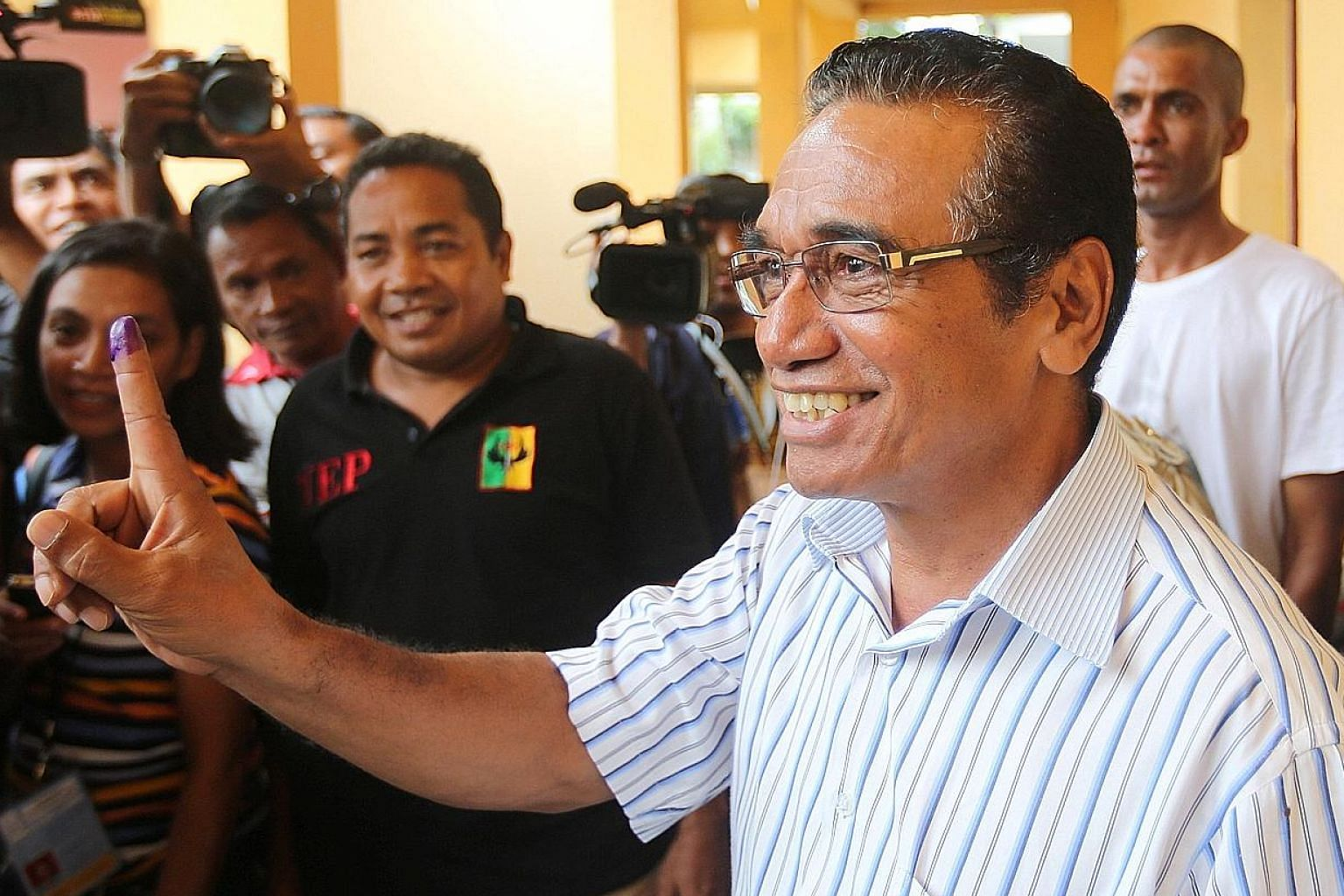 Mr Francisco Guterres with his inked finger after casting his vote on Monday. The Fretilin leader is set to be Timor Leste's president at a challenging time for the tiny half-island nation 15 years after it gained independence.
