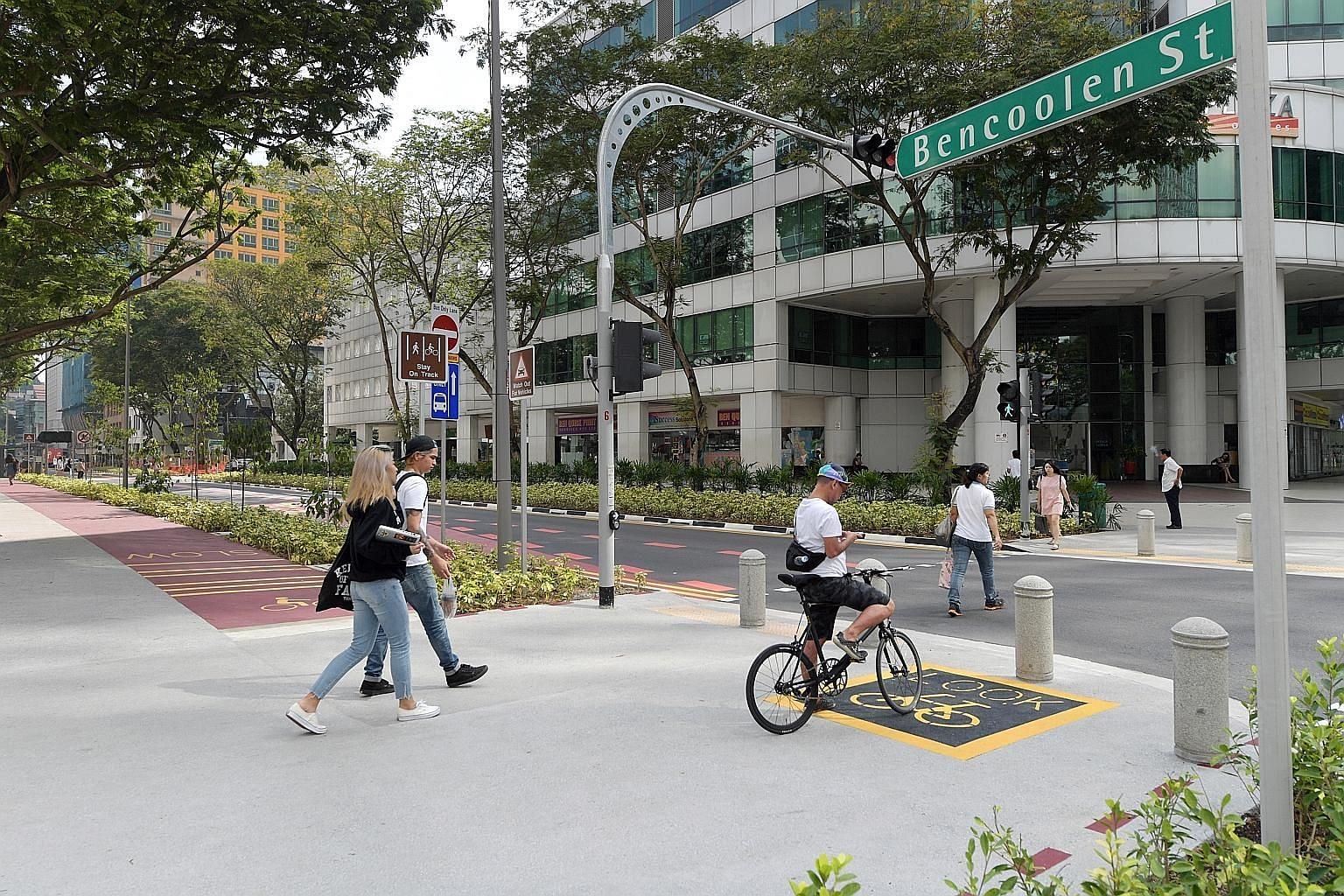 New features in Bencoolen Street include a wider pedestrian walkway and a cycling path as part of Singapore's car-lite drive.