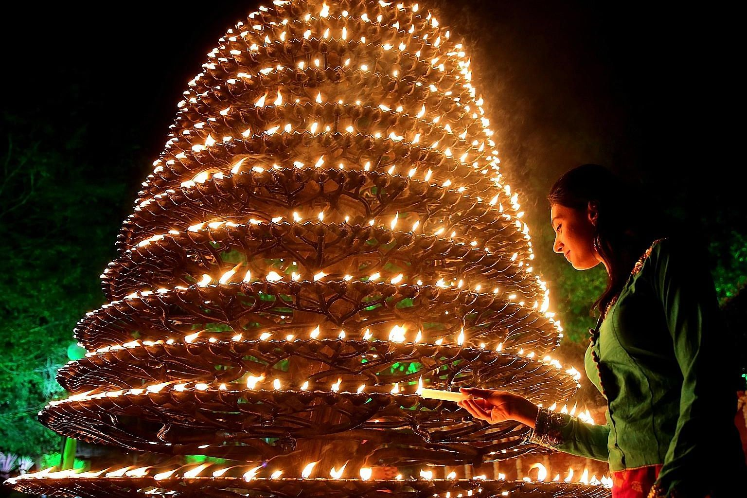 The traditional lamp of Kerala which has 1,001 wicks, known as Aal Vilakku, being lit to mark the 41st foundation day of Indira Gandhi Rashtriya Manav Sangrahalaya in Bhopal, India, on Tuesday. Indira Gandhi Rashtriya Manav Sangrahalaya, a museum by