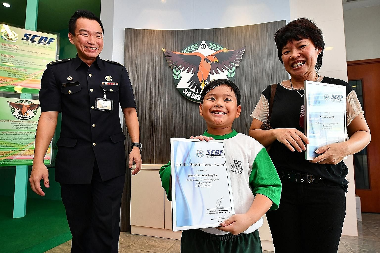 Lt-Col Chua, with Ms Liu and her son Phua Xiang Rong Rey. Every year, the SCDF responds to around 1,500 cases of rubbish chute fires.