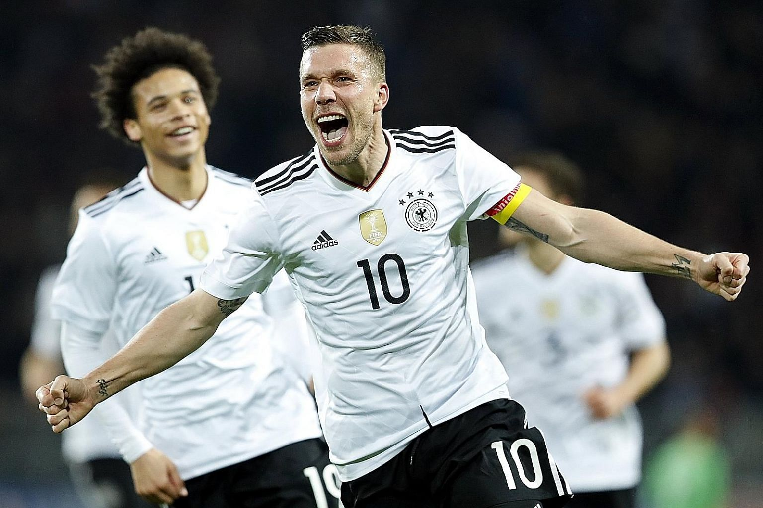 Lukas Podolski celebrating his 49th and final goal for Die Mannschaft. Podolski ends a glittering career for Germany, having won the 2014 World Cup.