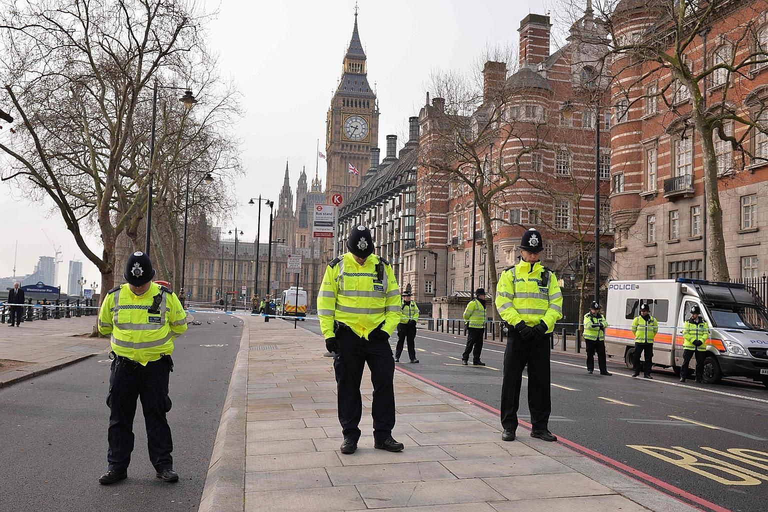 Police officers near Britain's Houses of Parliament joining in a minute of silence yesterday to commemorate the victims of Wednesday's terror attack.