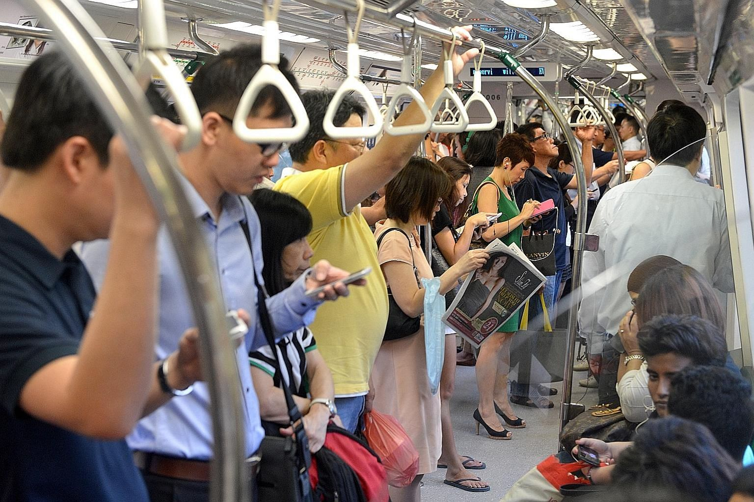 Grab poles in the train cabins are attached to the train's interior and not connected to the external frame, according to SMRT in a blog post last year. Even if a commuter is holding onto one when lightning hits, he would be unaffected.
