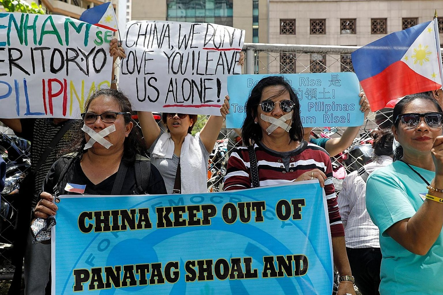 Filipinos protesting outside the Chinese Embassy in Manila earlier this month over reports that China would start preparations to build an environmental monitoring station in the South China Sea.