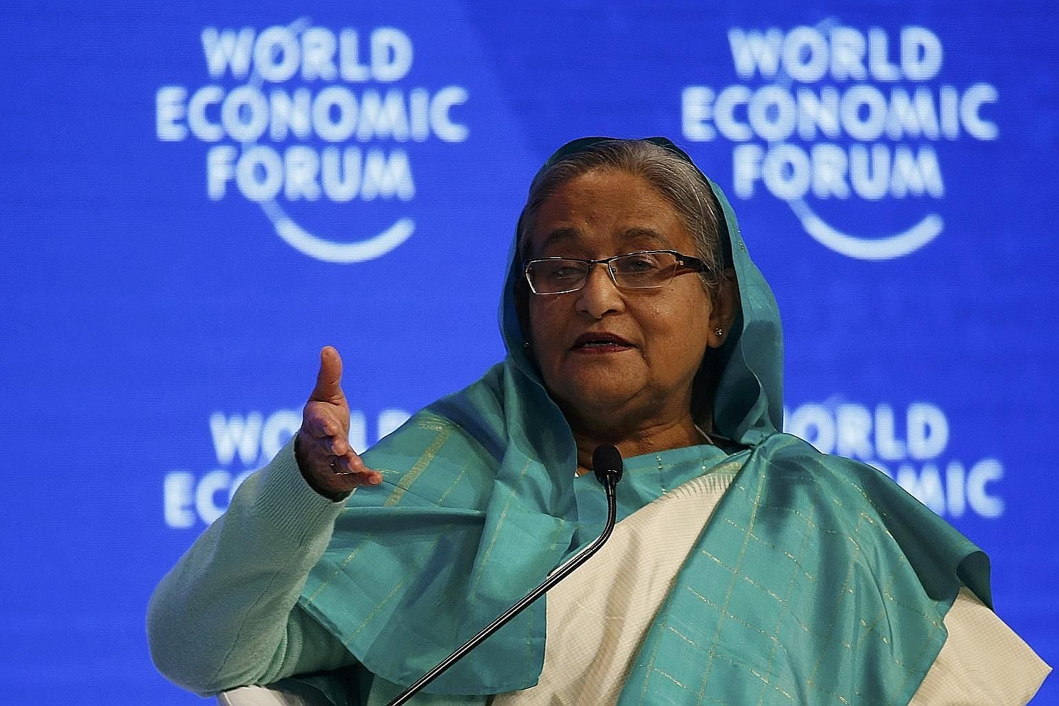 Bangladesh Prime Minister Sheikh Hasina has forged close ties with both India and China. The writer says Bangladesh must not take sides in any India-China rivalry.