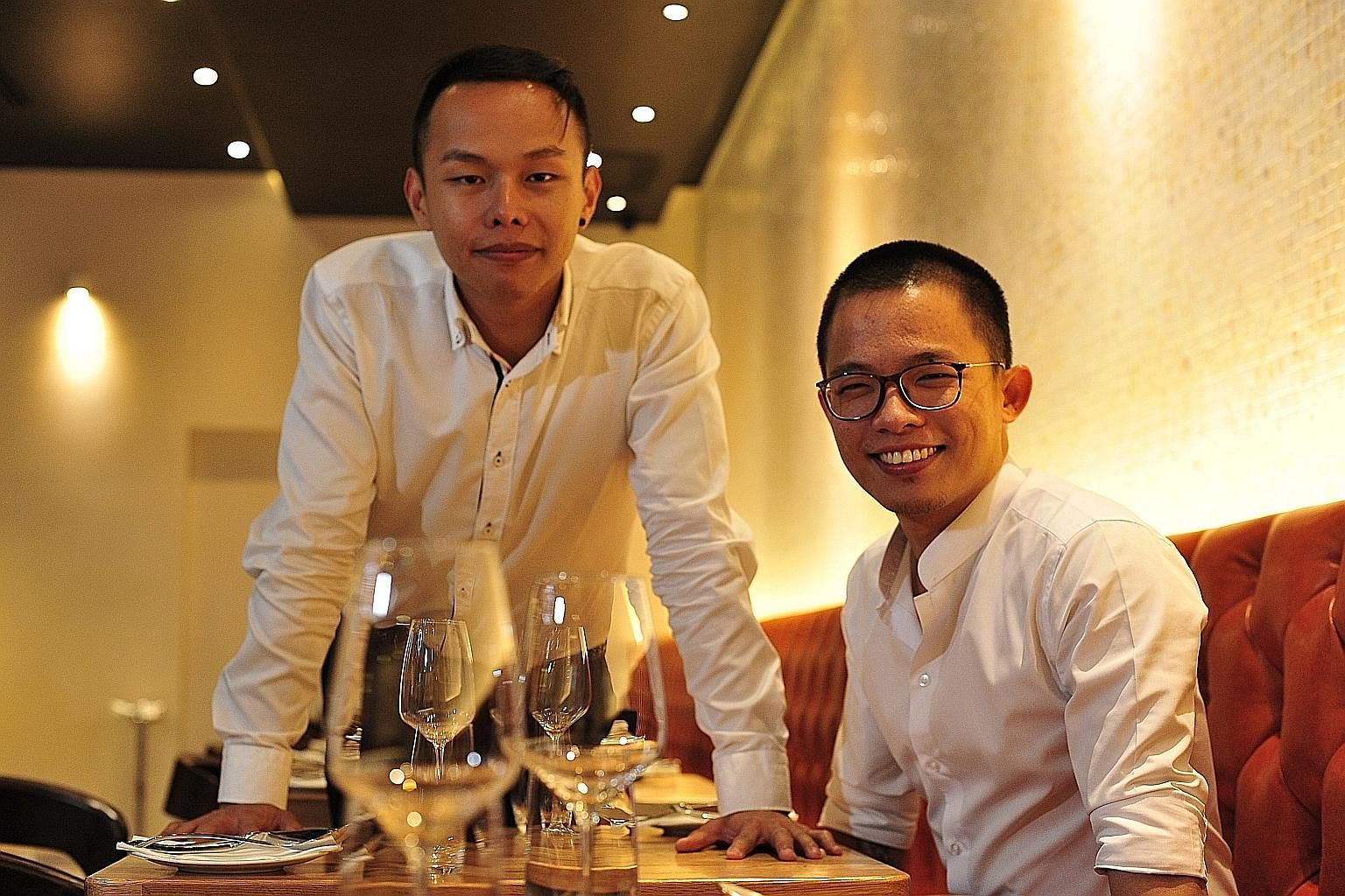 Saveur co-founder Joshua Khoo (left) now runs a hawker stall, while chef Dylan Ong is opening a casual restaurant next month.