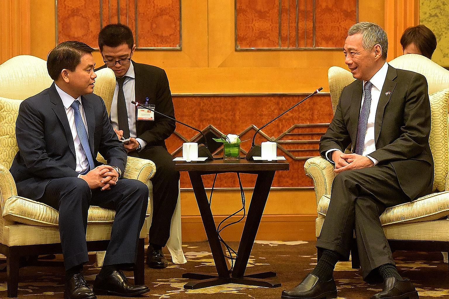 Hanoi People's Committee chairman Nguyen Duc Chung calling on PM Lee at a hotel in Vietnam's capital city yesterday.