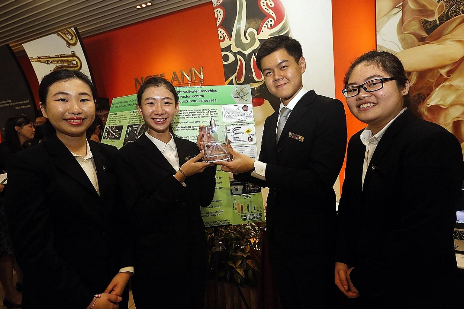 The project of Republic Polytechnic students (from left) Fennatika Salim, Lhu Ying Xuan, Ong Joo Kian and Tan Min Hui, all aged 21, was among 10 recognised with a Polytechnic Student Research Programme Award. Their sunlight-activated larvicide is 1,000 ti