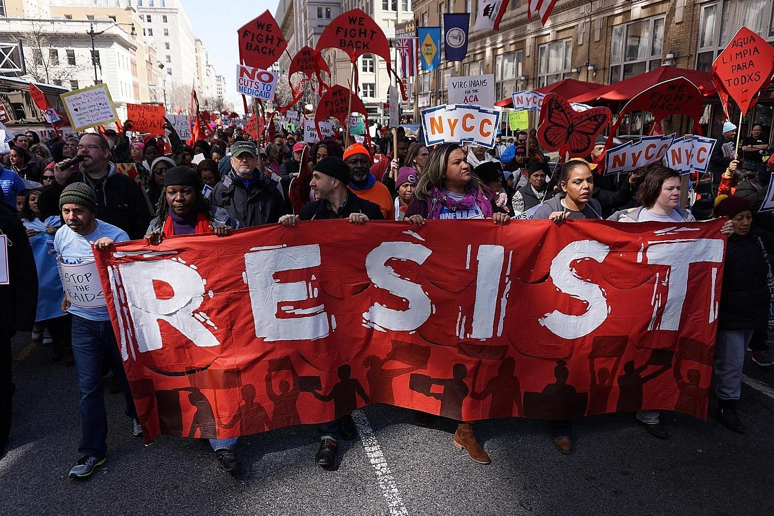 Protesters at a rally against Mr Trump's healthcare reform Bill in Washington last Thursday. With the Bill's withdrawal, markets are more concerned with whether the administration can overhaul the tax code and implement tax cuts and infrastructure sp