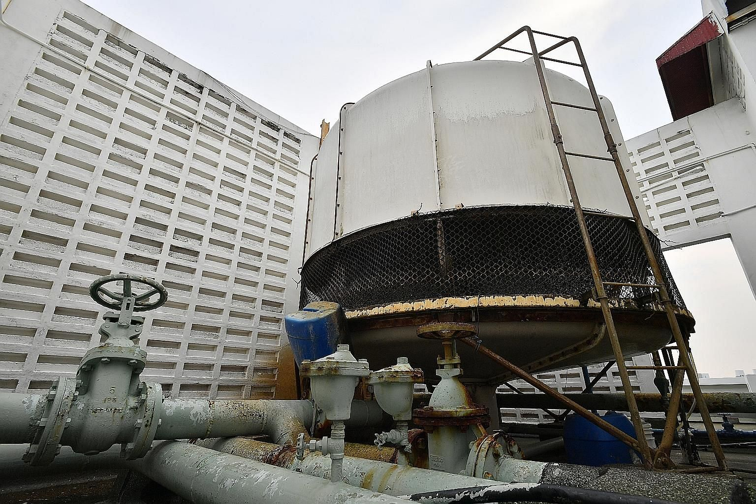 The central cooling tower on one of the blocks at Leonie Towers. A majority of residents want to dismantle the condo's cooling system