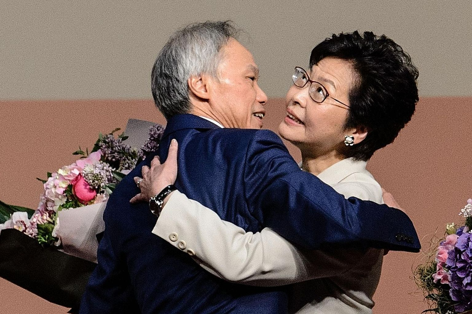 Mrs Carrie Lam with her husband of 32 years, Mr Lam Siu Por, after her win yesterday. She had planned to spend some time with him in Britain after retiring from her chief secretary job in July, but Mr Lam persuaded her to run in the chief executive e