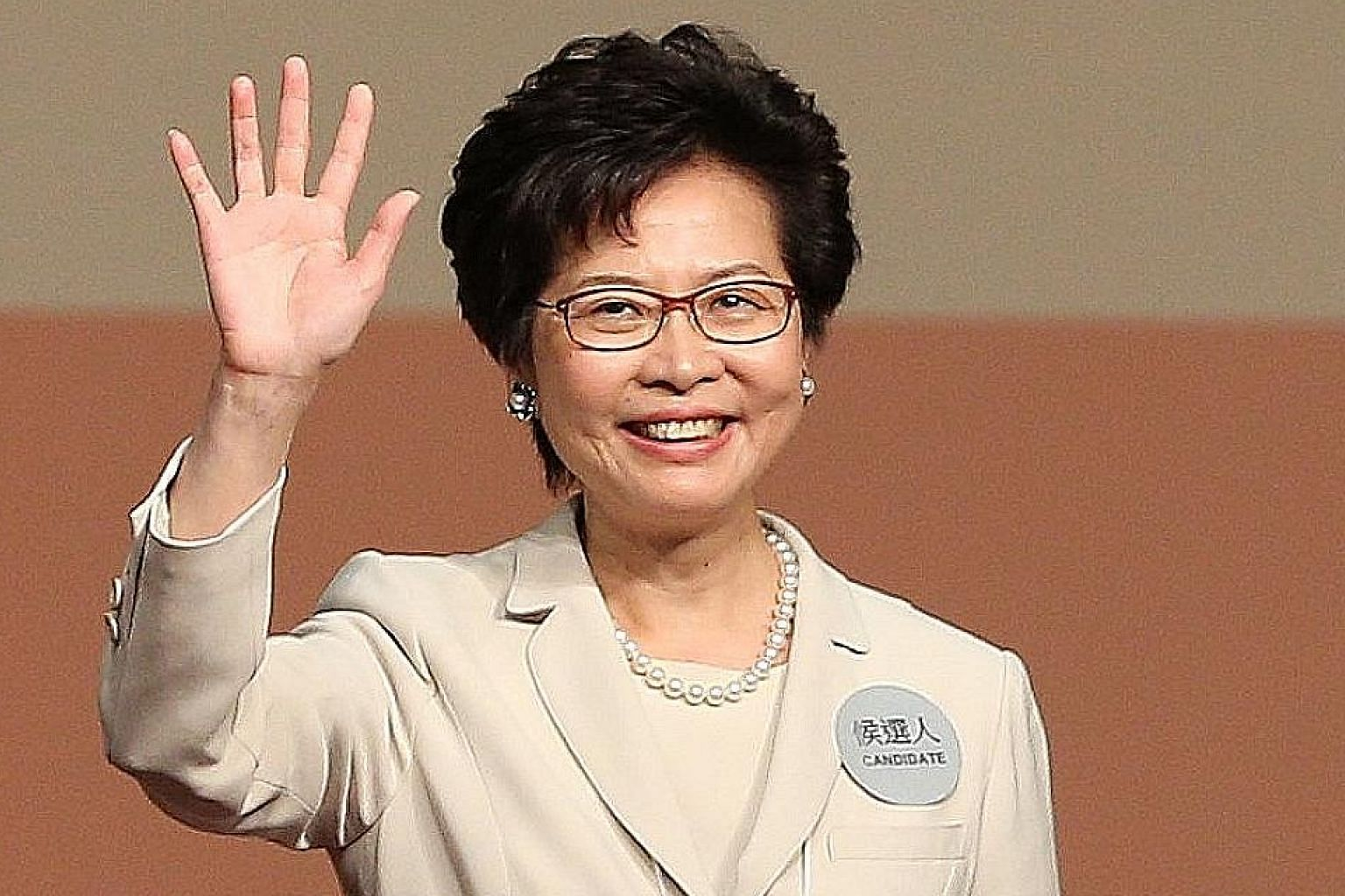 "Mrs Lam vowed to safeguard Hong Kong's core values and uphold the ""one country, two systems"" framework."