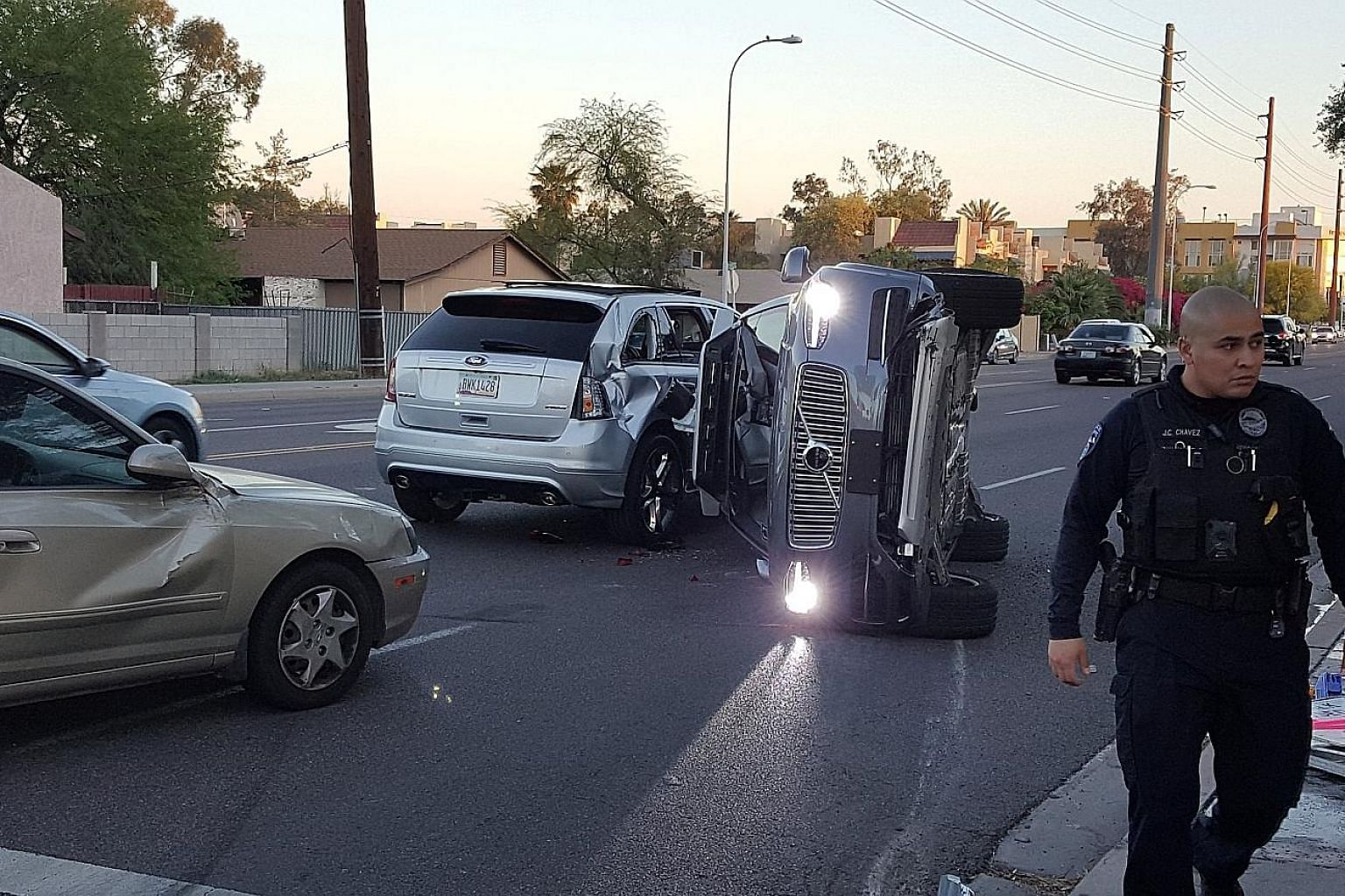 A self-driven Volvo SUV owned and operated by Uber lying on its side after a collision with another vehicle in Tempe, Arizona, flipped it over.
