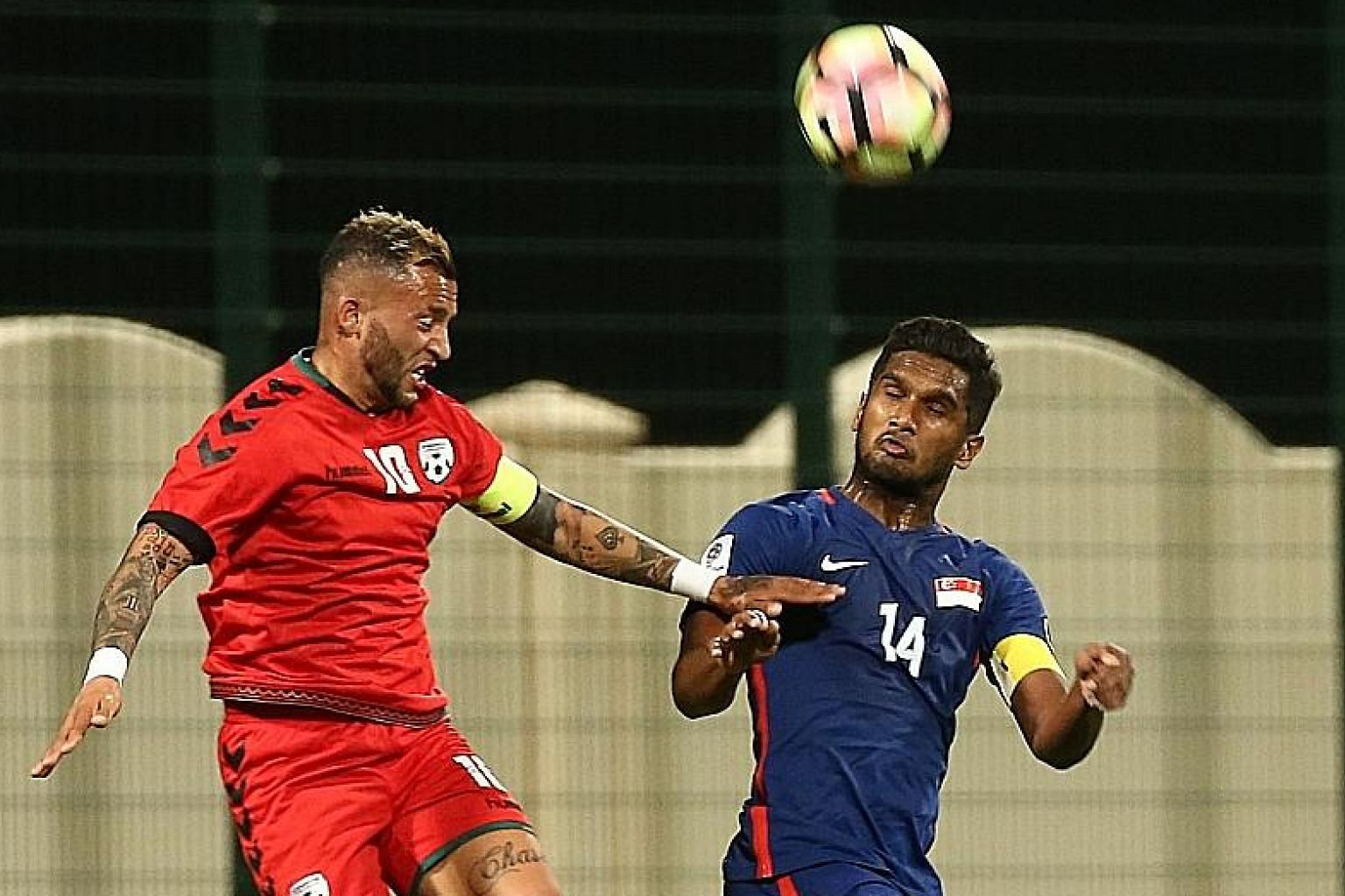 Hariss Harun, captain for the friendly against Afghanistan last week in Doha, challenging Faysal Shayesteh in the 1-2 loss. He says that although a point will be great against Bahrain tonight, the team will hope to win.