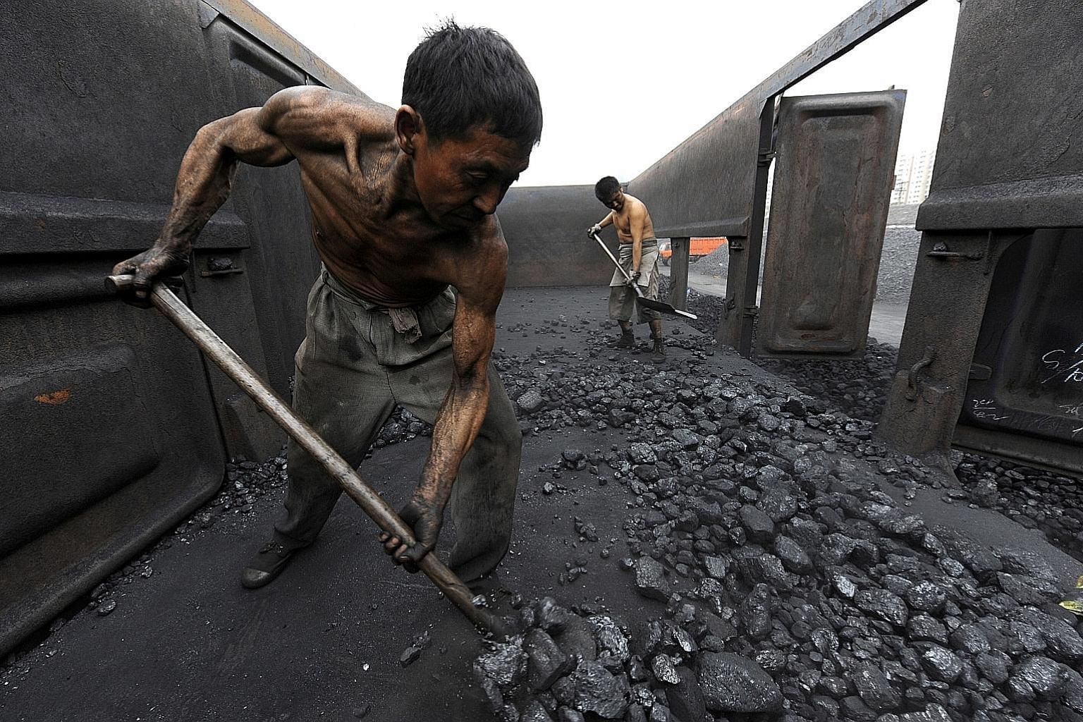 China's industrial profits rose 8.5 per cent in 2016, largely due to a sharp rise in prices of coal (above) as well as raw materials such as iron ore.