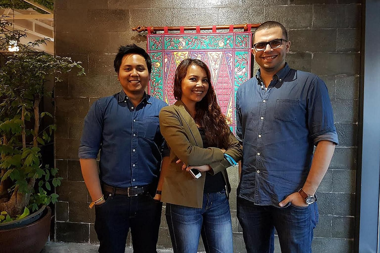 Mr Royono (left) with his Snapcart colleagues Teresa Condicion, co-founder and chief data officer, and co-founder Laith Abu Rakty, who is also chief technology officer.