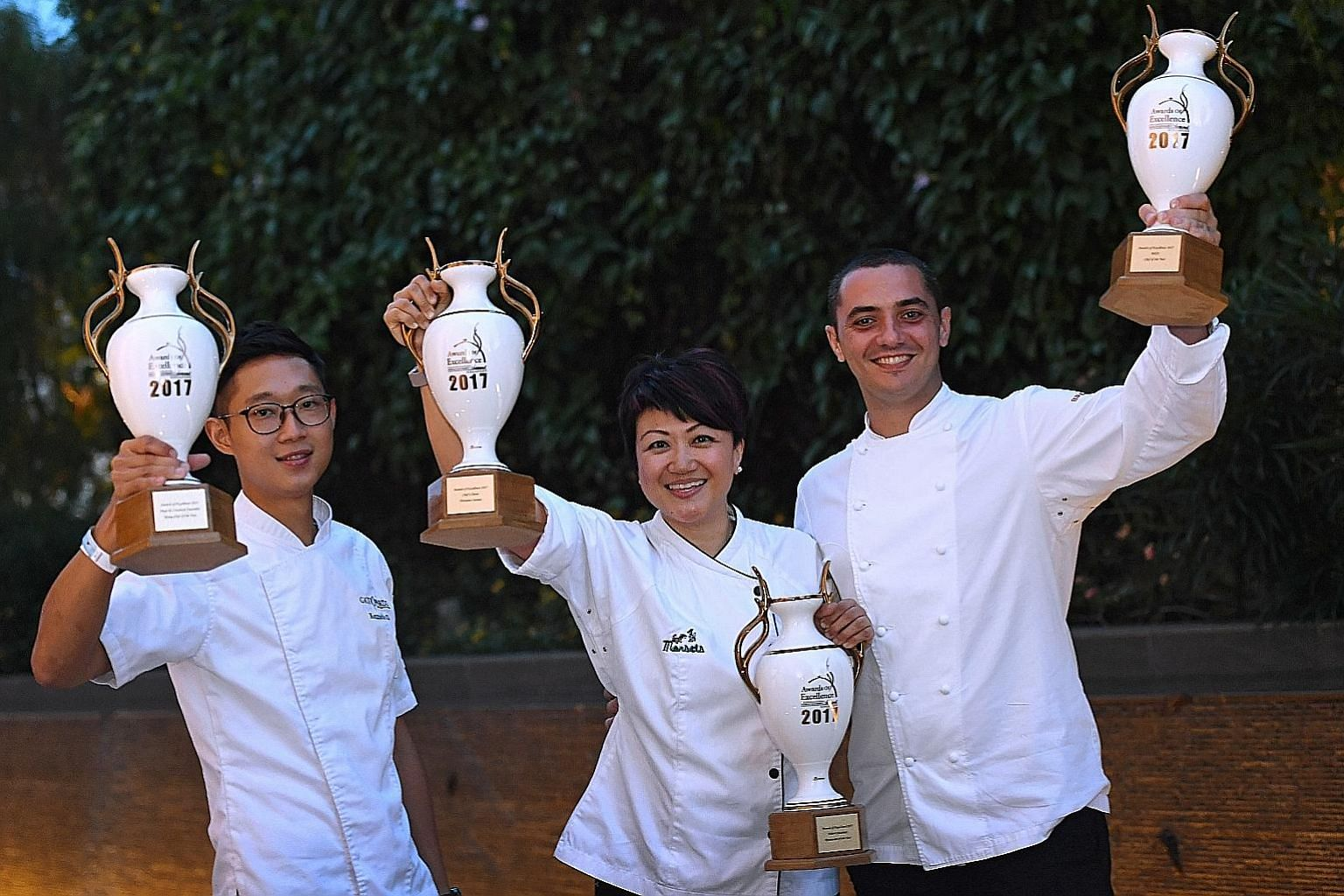 Winners all (from far left): Chef de Cuisine of Gattopardo Ristorante di Mare, Kenneth Oh, who took home the Rising Chef of the Year award; Petrina Loh, chef-owner of Morsels, which won Restaurant of the Year and Chef's Choice (Western Cuisine) award