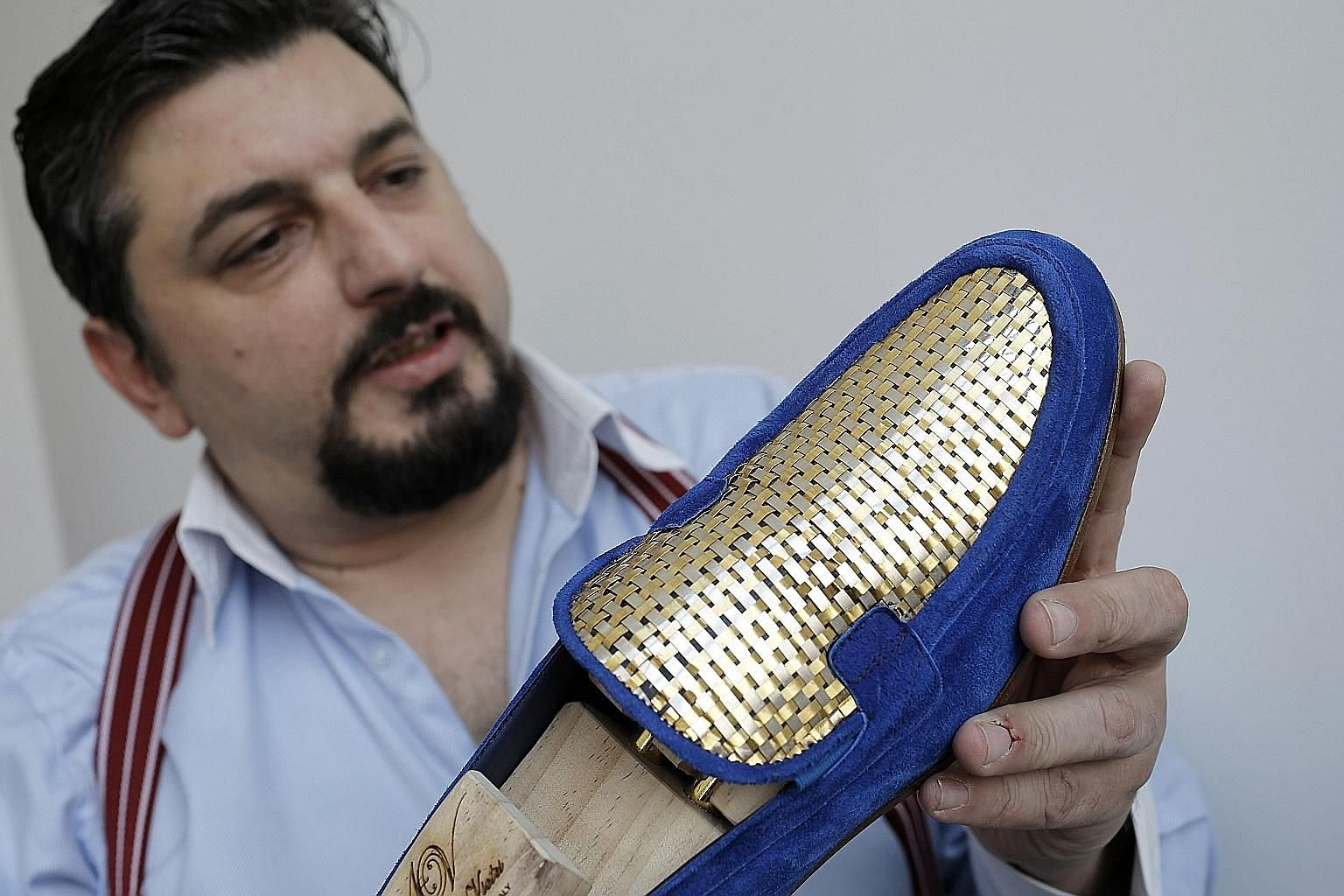 """Filthy rich and already boast enough glass slippers? Shoemaker Antonio Vietri from Turin, Italy, hopes to attract shoppers from wealthy Gulf countries with his 24K gold shoes: blue or black suede moccasins with stitched gold-plated uppers. """"The parti"""