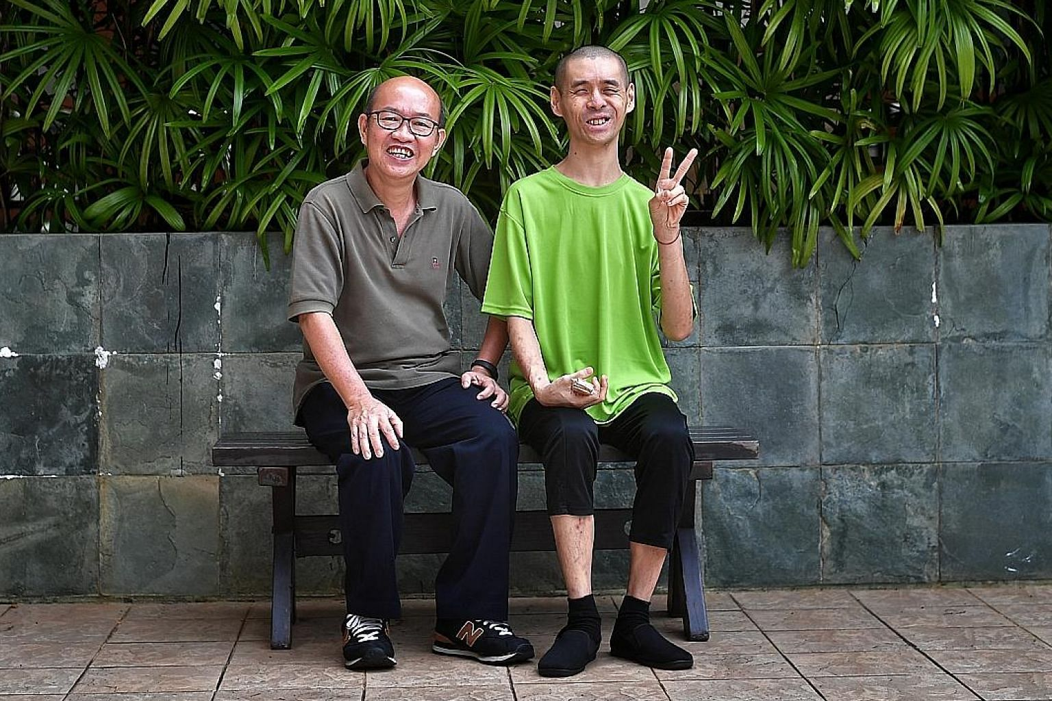 Mr Tan Ngan Seng (left) opened an account with the Special Needs Trust Company for his cousin Ong Yeow Ping, who has intellectual disability, and applied to be his deputy - which allowed him to help Mr Ong sell his inherited flat. Mr Ong lacked the m
