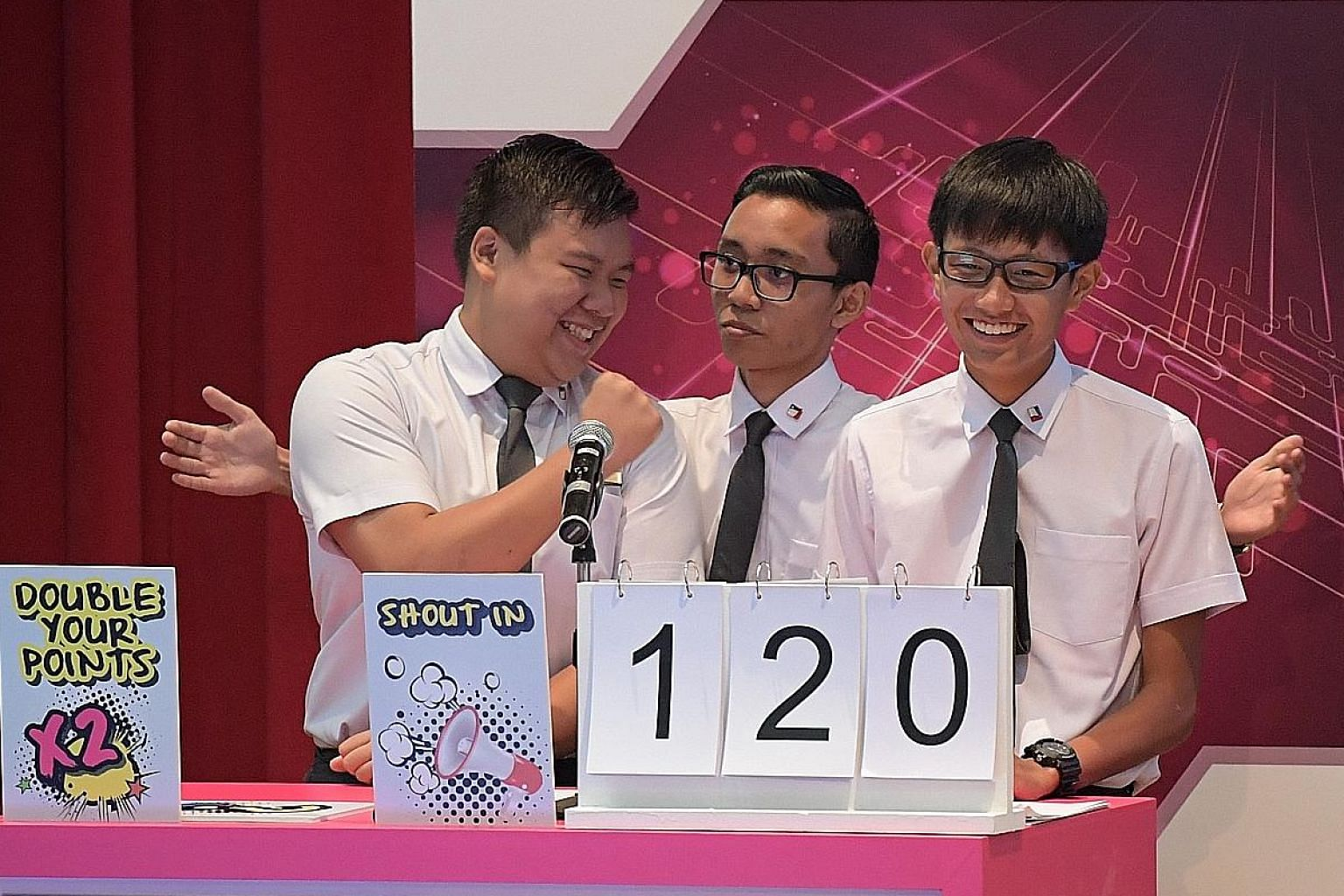 Pioneer JC team members (from left) Clifford Foo, Syakir Mohaium and Ethan Lim, 18, at the first round of this year's The Big Quiz yesterday. They beat two teams from Jurong JC and one from Millennia Institute to emerge as champions.