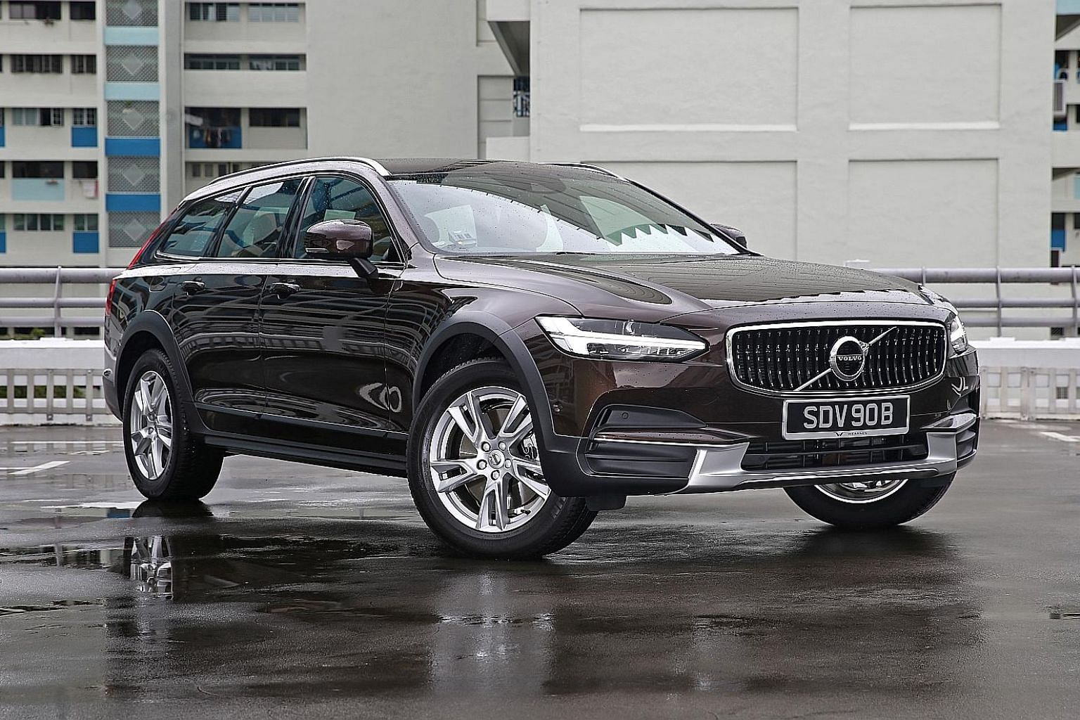 Volvo V90 Cross Country's raised chassis makes it easier to get into and out of. Its cockpit is dominated by a 9-inch iPad-style infotainment touchscreen and its boot is spacious.